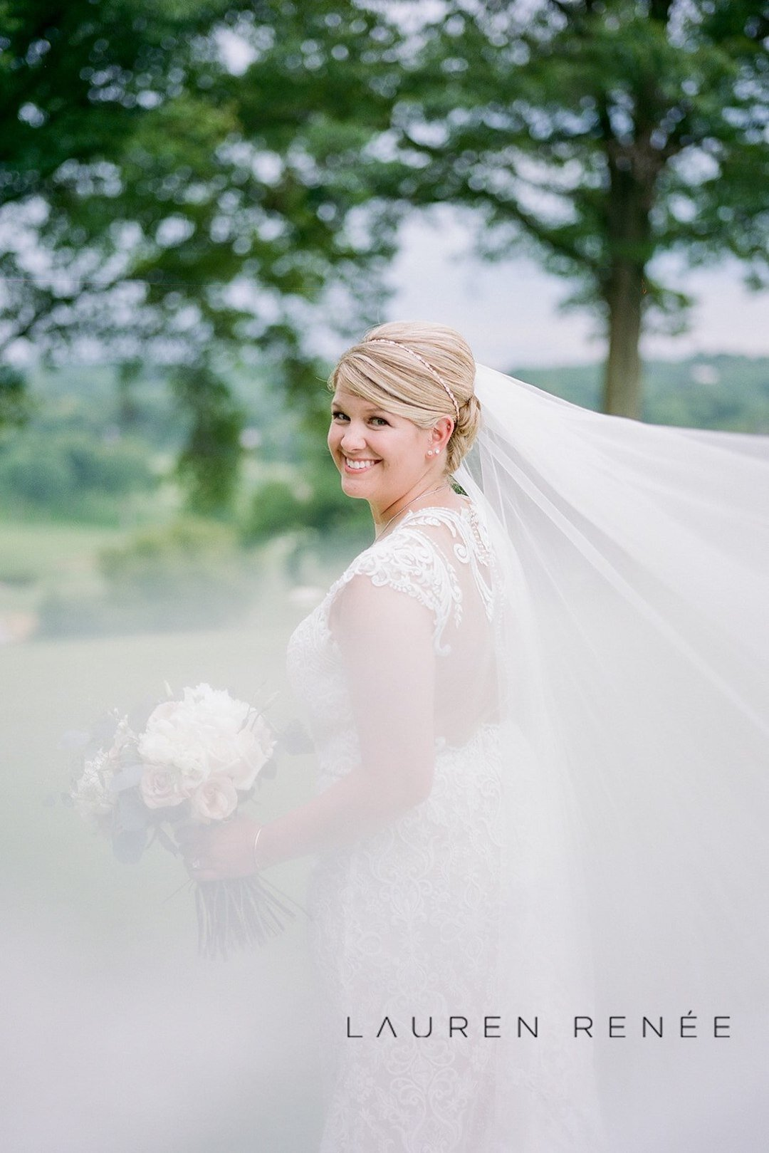 Bride photo with veil: Romantic Blush Wedding at the Pittsburgh Field Club planned by Exhale Events. See more at exhale-events.com!