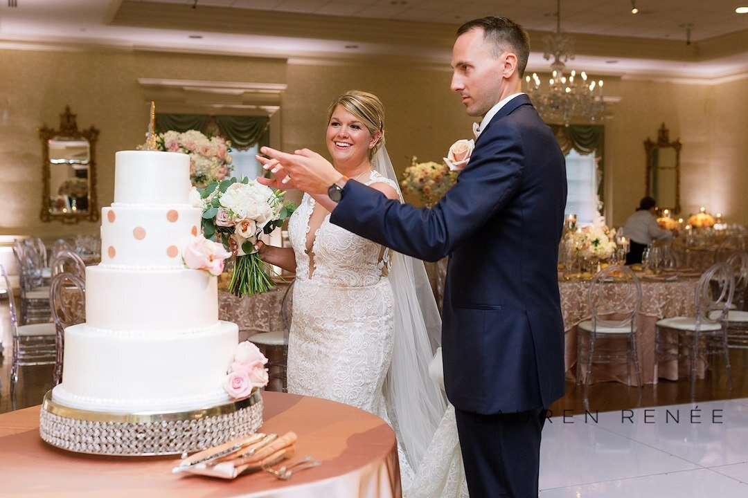 Bride and Groom cutting cake: Romantic Blush Wedding at the Pittsburgh Field Club planned by Exhale Events. See more at exhale-events.com!