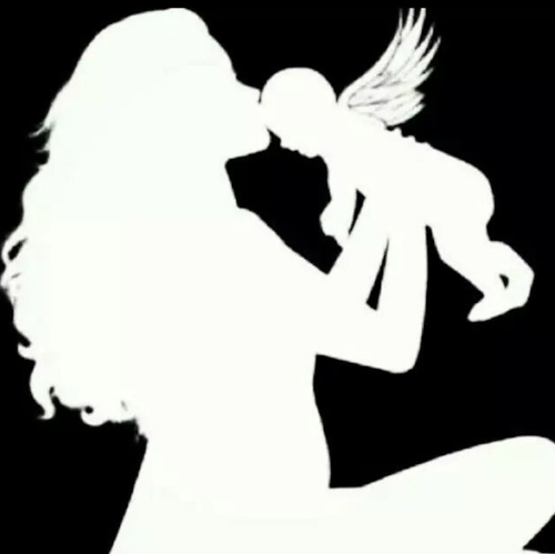 This silhouette of a mother kissing her angel baby is a favorite image of Kristen's.