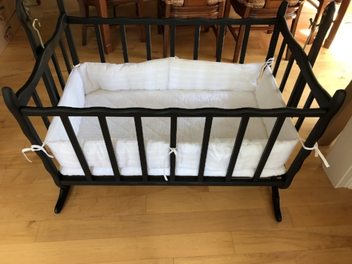 This is a picture of the cradle I restored to use in my infertility exhibit.