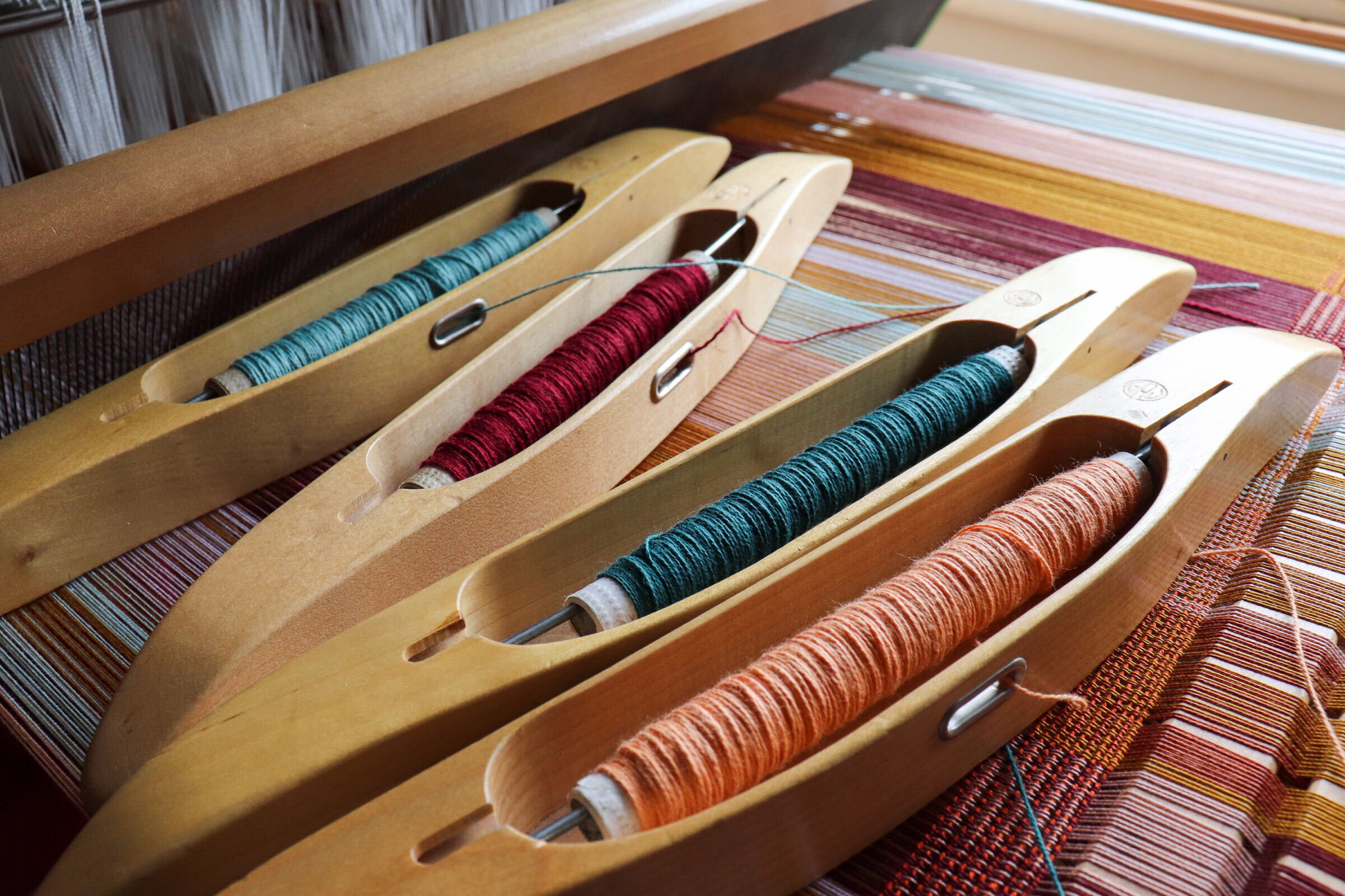 By Cecil hand loom and shuttles with cotton spools