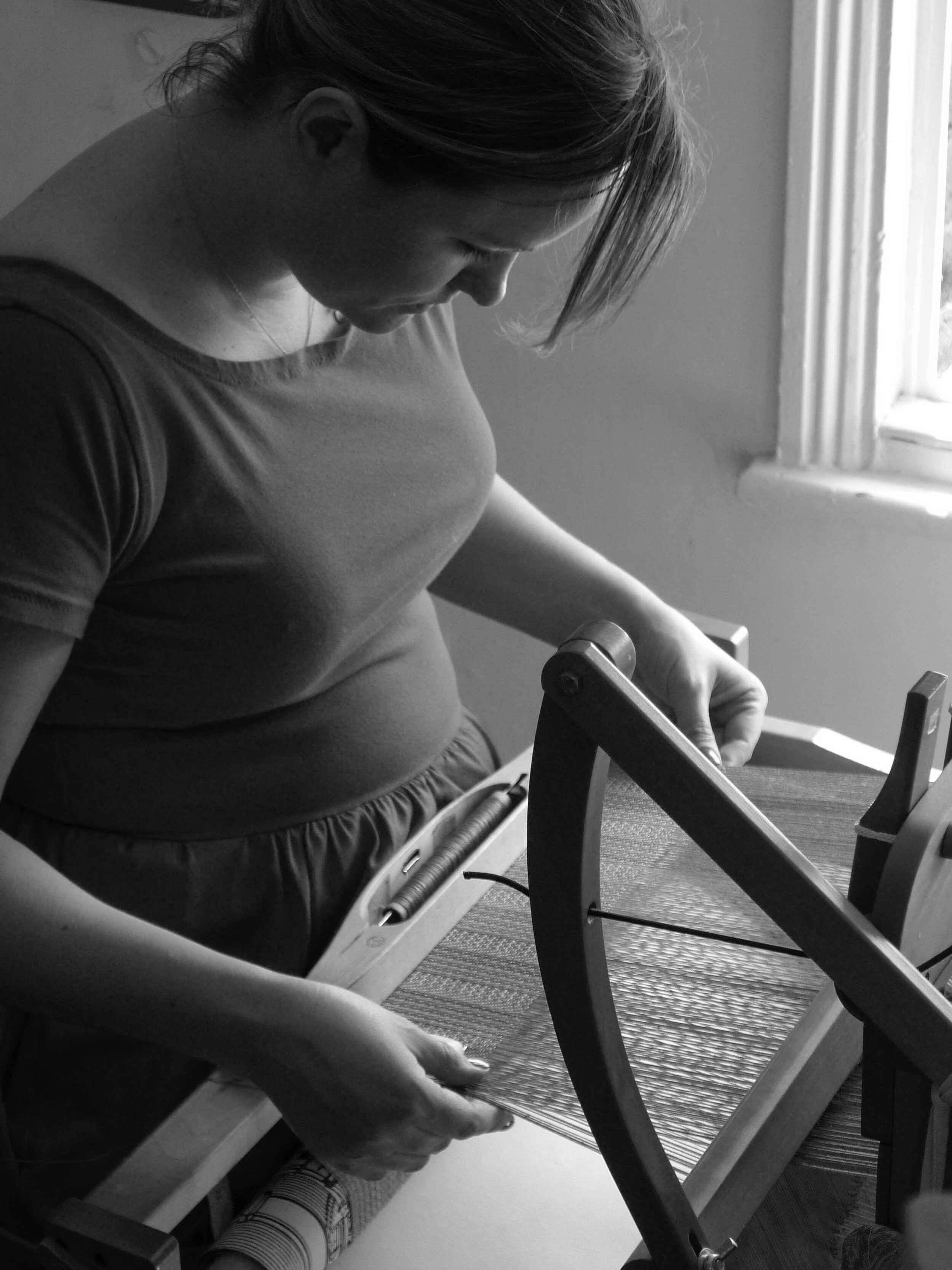 Cecilia of By Cecil at her loom