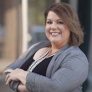 Sarah Koch joined the GRACE Cancer Foundation in June 2018 as Executive Director.  Sarah joins GRACE with a strong knowledge and diverse background in both for profit and non-profit marketing, recruitment and fundraising. She was previously the Marketing, Recruitment and Training Director for Heartland CASA. Prior to that, Sarah was Marketing and PR Coordinator for Active Family Chiropractic, served as a licensed insurance agent with State Farm, and worked in orthodontics as a certified dental assistant. She attended Southeast Community College, and is currently a member of the Grand Island Chamber Young Professionals as well as a Board Member for ACAP (Association for Child Abuse Prevention). She was also selected to the Chamber's Top 35 Under 35.  Sarah is very excited for this new opportunity with the GRACE Foundation and looks forward to working within Grand Island and the surrounding communities.  A native of Lemoyne, Nebraska, Sarah grew up on Lake McConaughy, and moved to Grand Island with her husband Brandon in 2015. Brandon is a Sprayer Technician with Simpson Farm Enterprises, and they are parents to Gracyn as well as two labs, Pippi and Maggie. Sarah and her family love spending time together outdoors, especially at the lake.