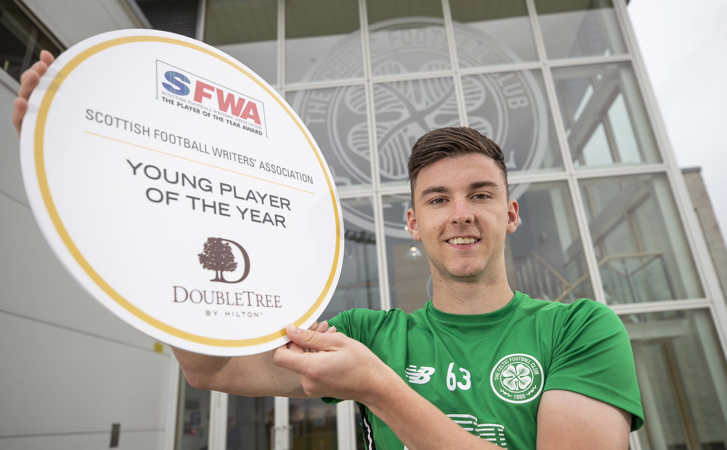 Kieran Tierney celebrates winning the SFWA Young Player of the Year award