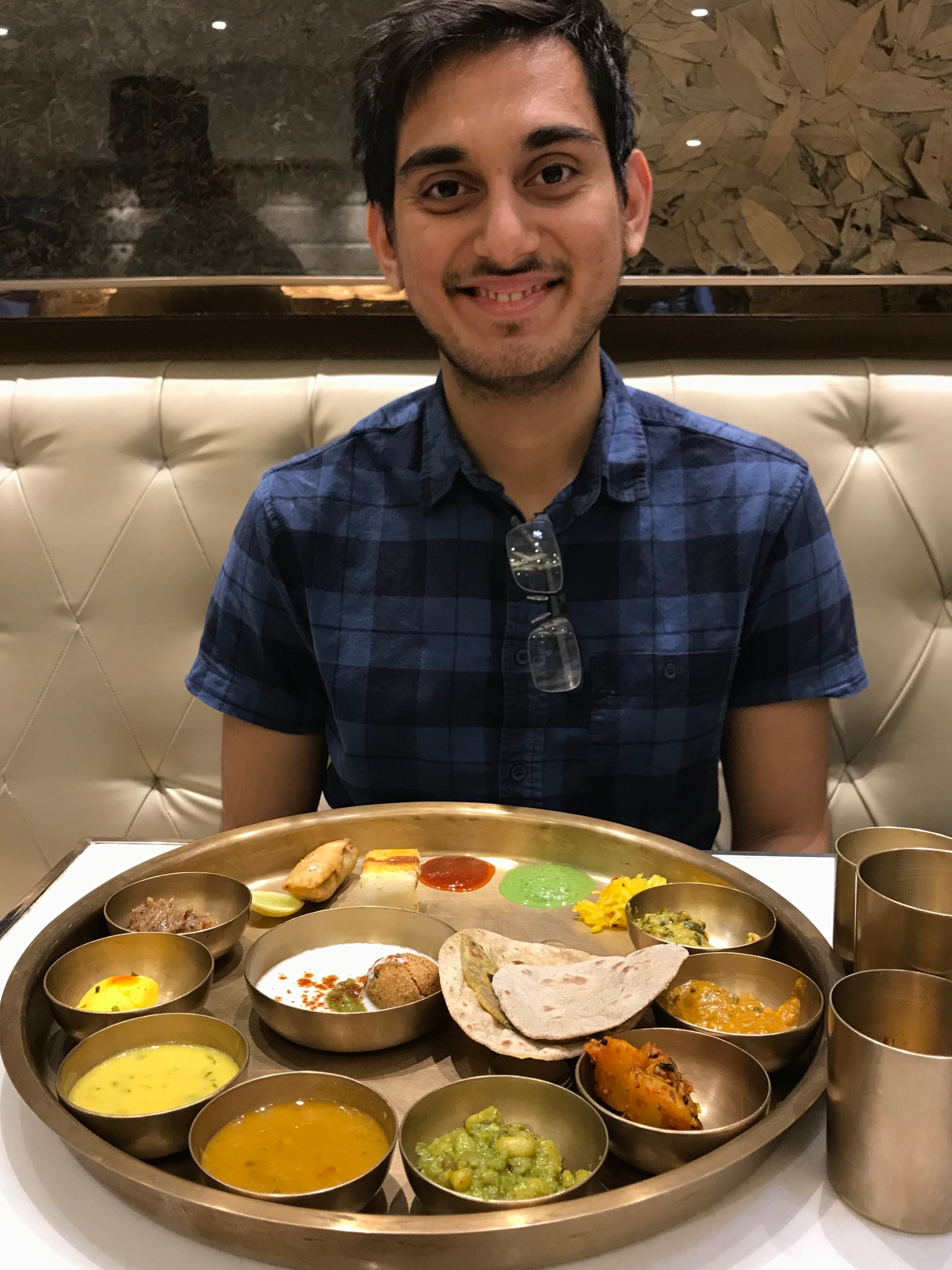 Me just before eating one of the best meals of my life, when out for lunch with my Dad (photo credits) in India.