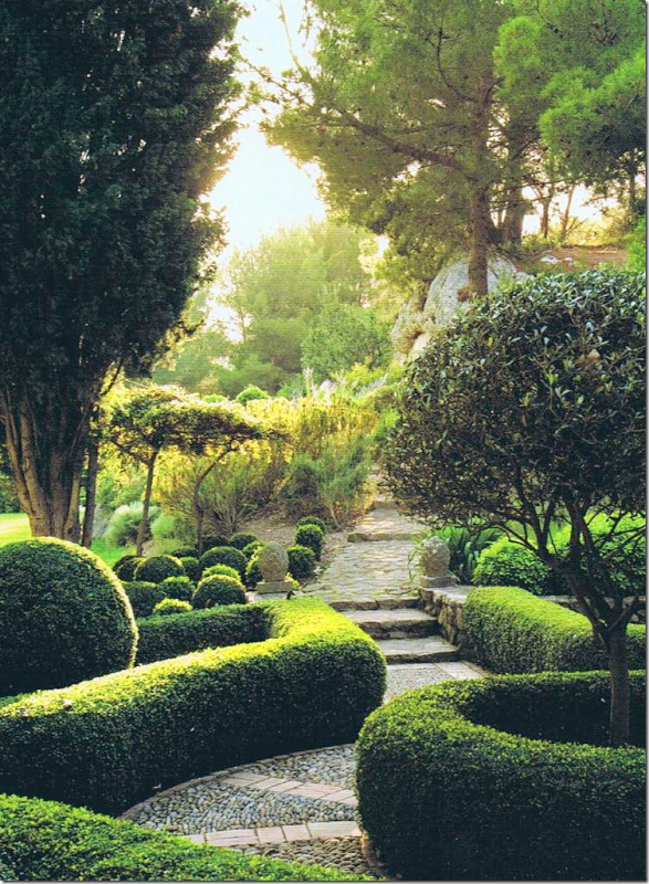 French garden with boxwoods, labyrinth pathways.