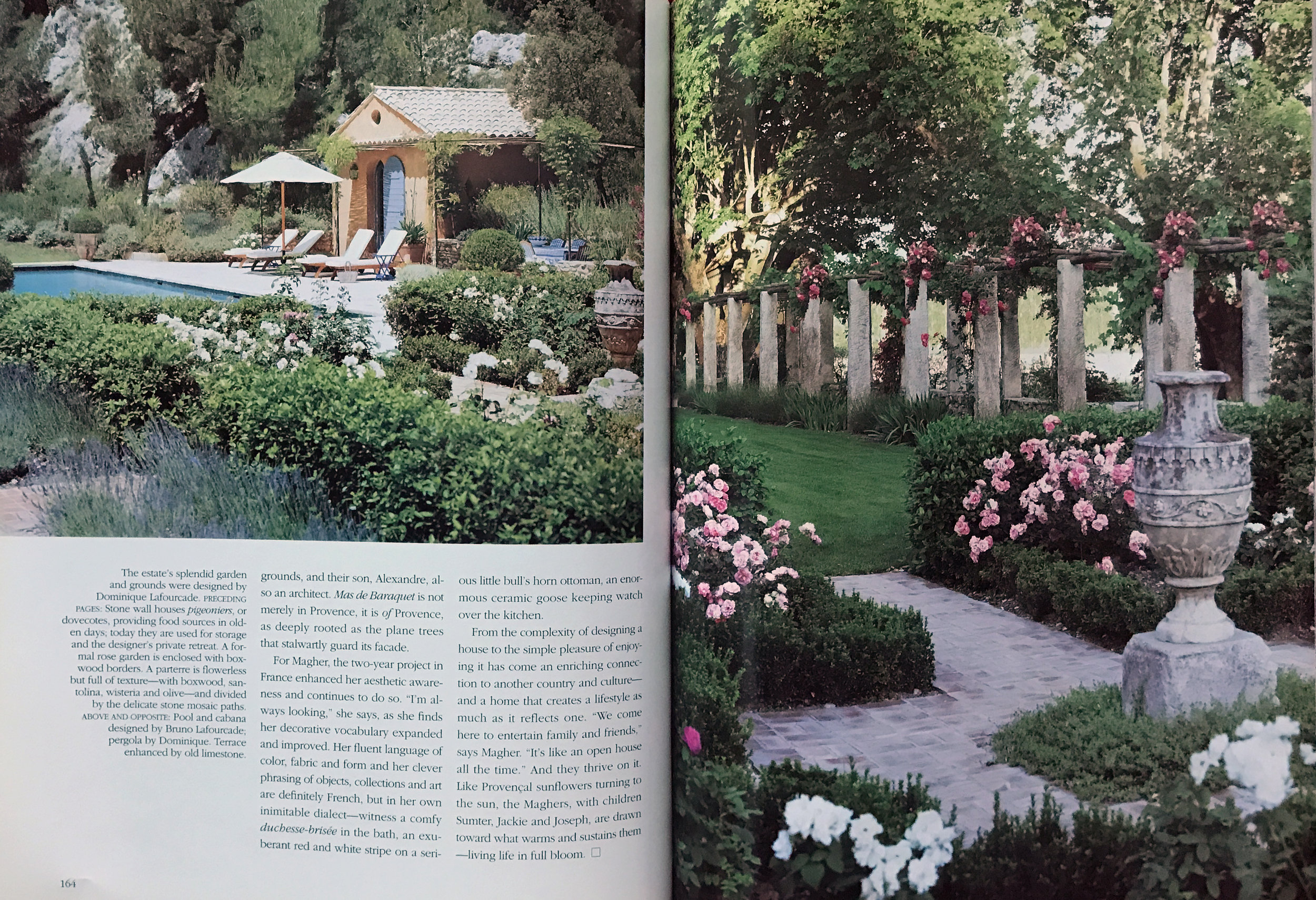 French gardens with roses and boxwood near pool.