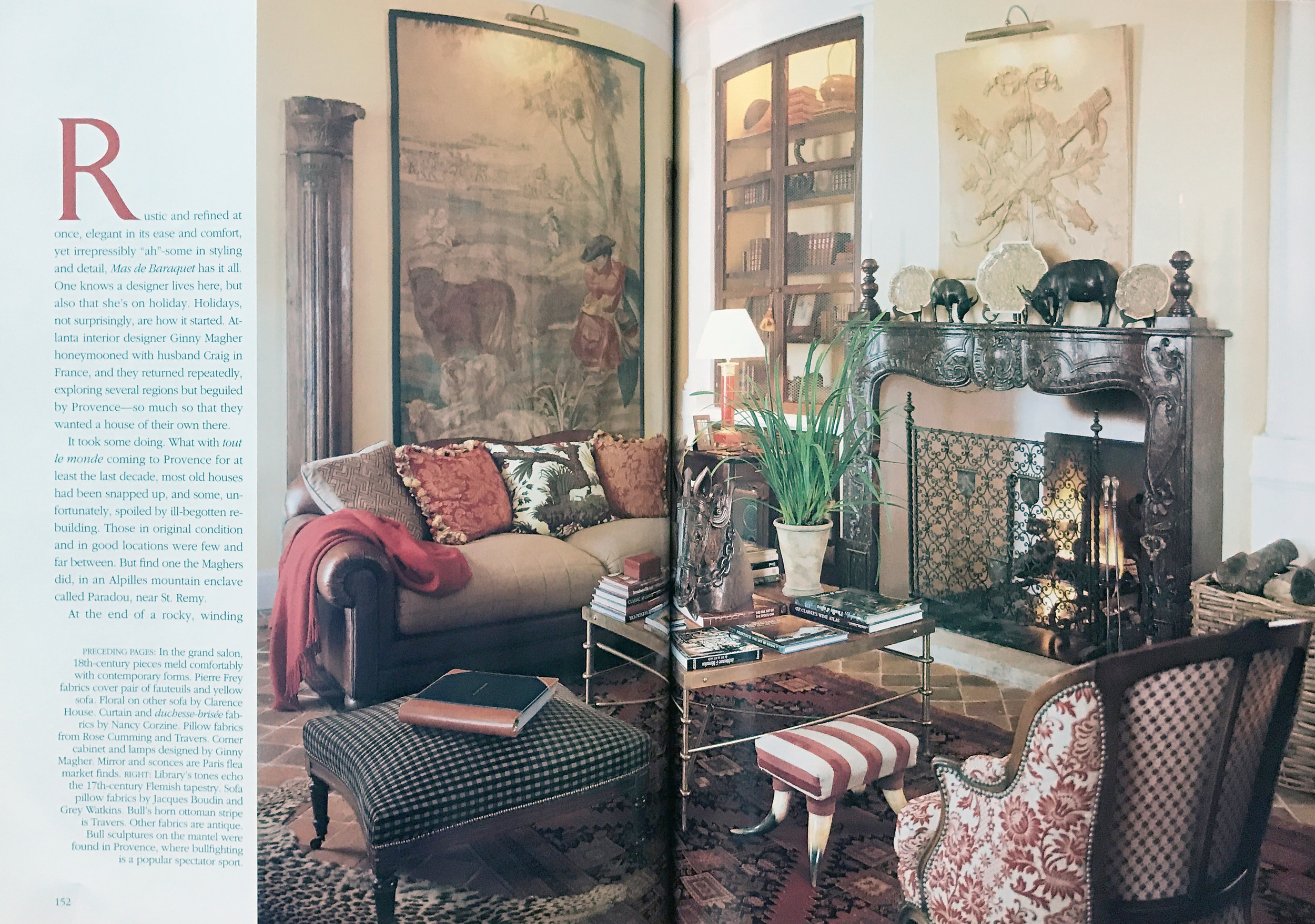 Fireplace, art, and rug in a French living room design by Ginny Magher