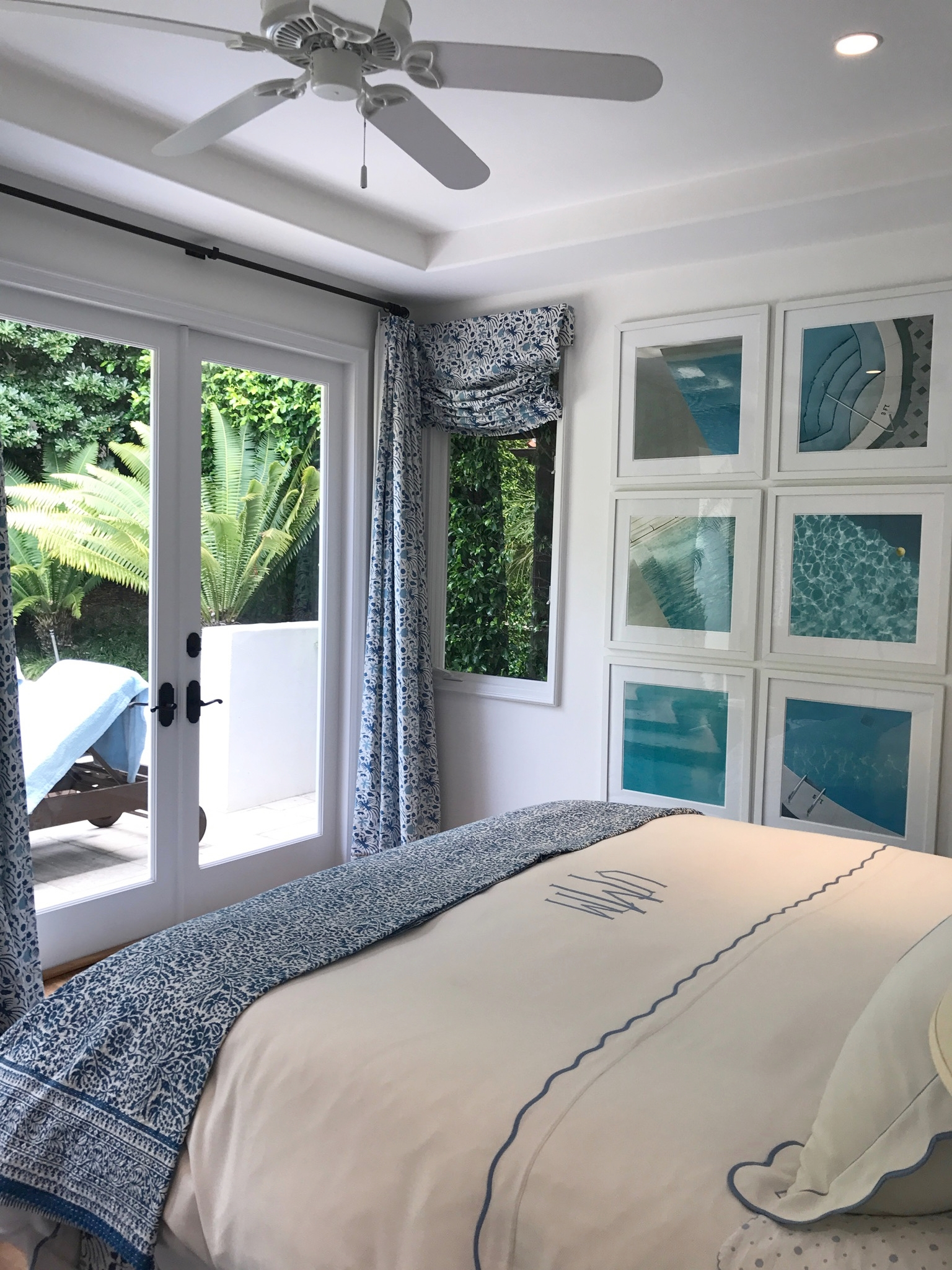 Guest room in Laguna beach with French doors and pool photos.