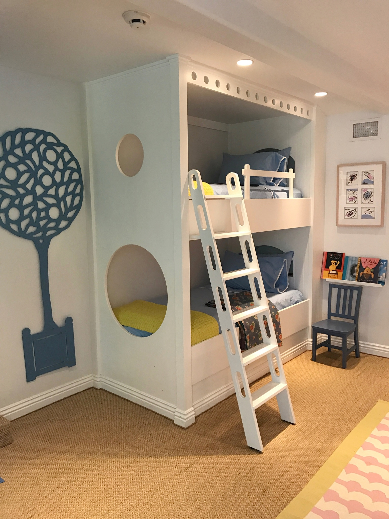Bunk room with two beds and ladder in Laguna Beach featuring a tree cut out on wall.