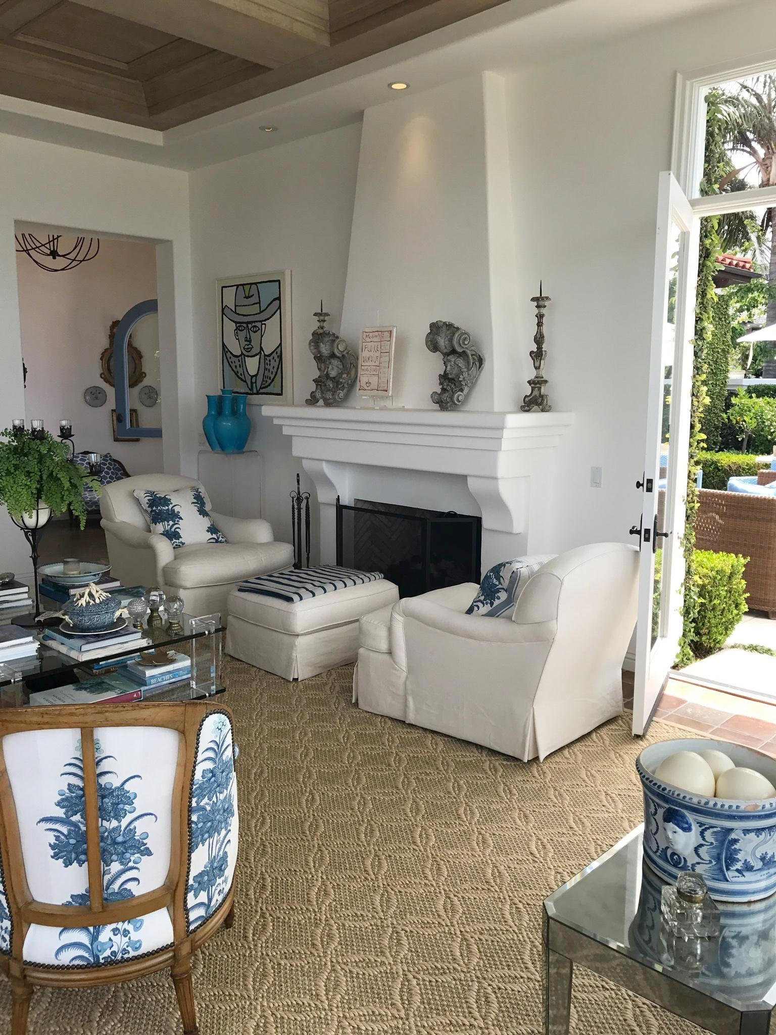 Laguna Beach living room design with French style chairs and fireplace.