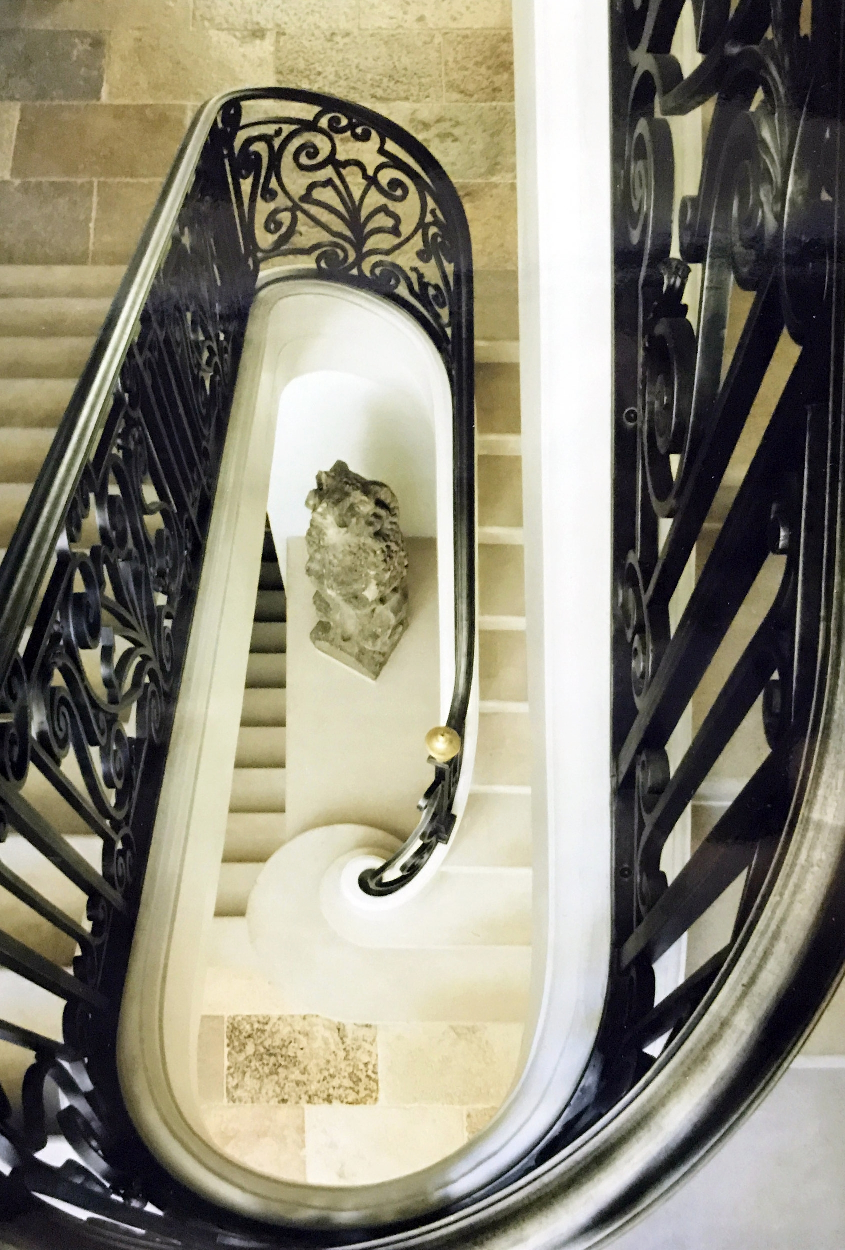 Spiral staircase in Parisian style home.