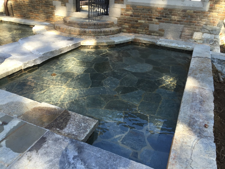 raised spa granite veneer - wet edge evergreen plaster finish
