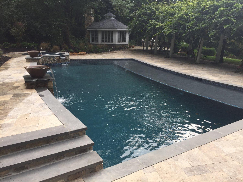 25' x 45' pool - 45' shelf - raised octagonal spa - diamond brite french gray plaster finish - blue stone coping - travertine patio