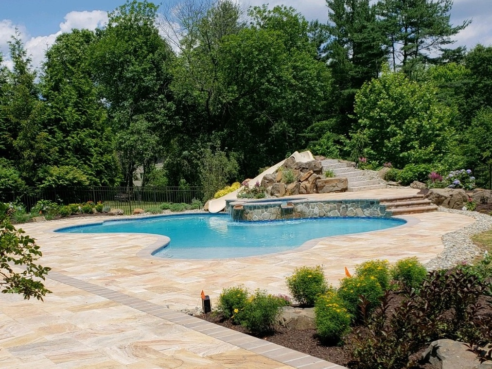 - Hydrazzo bimini teal plaster - 15' dolphin slide built up with boulders and natural stone steps - travertine patio -