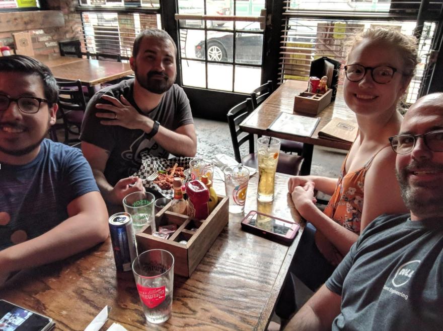 Josh t aking part in old-school social media selfie with Paco, Ryan, and Lauren.