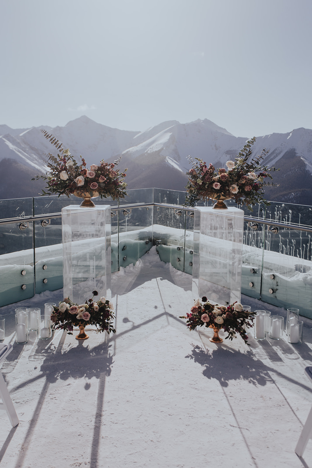 Outdoor winter wedding at Sky Bistro Banff, Flowers by Janie, pedestals of flowers.jpg