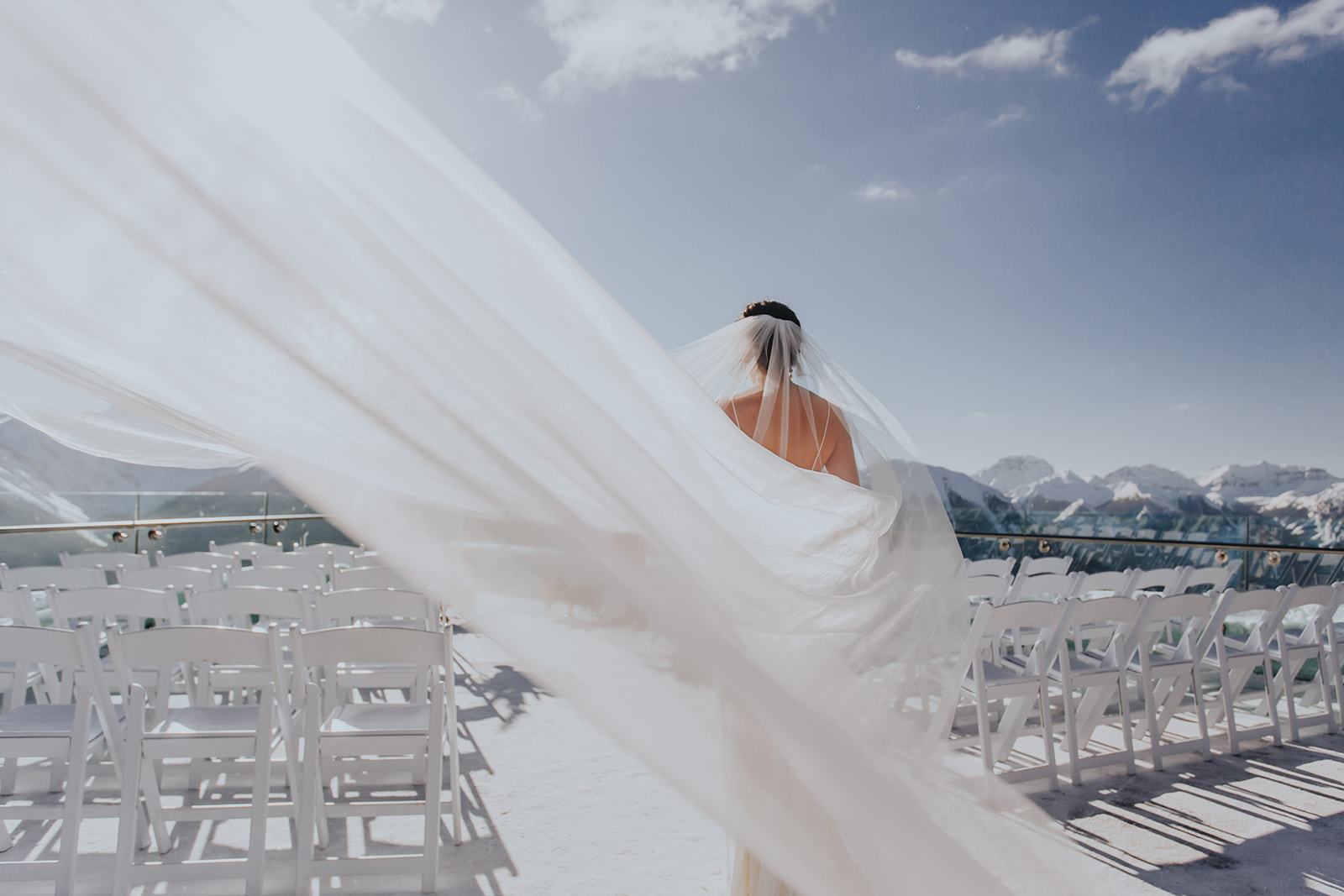 Bride with long veil, Sky bistro Banff wedding.jpg