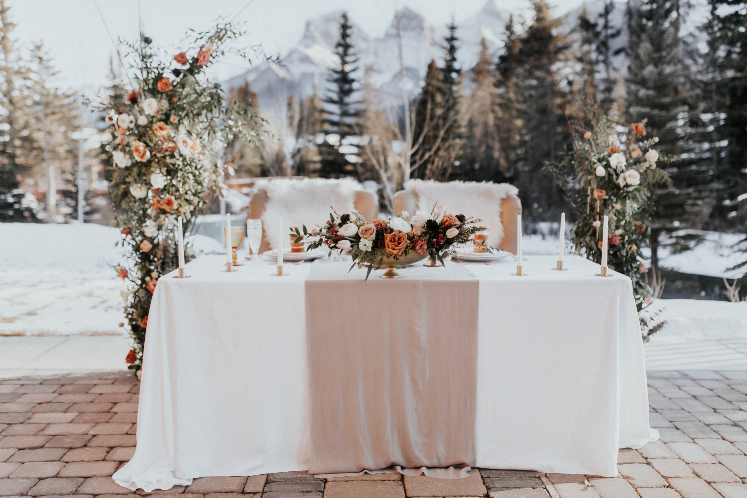 Sweetheart table Canmore wedding with floral columns and toffee roses, Flowers by Janie.jpg