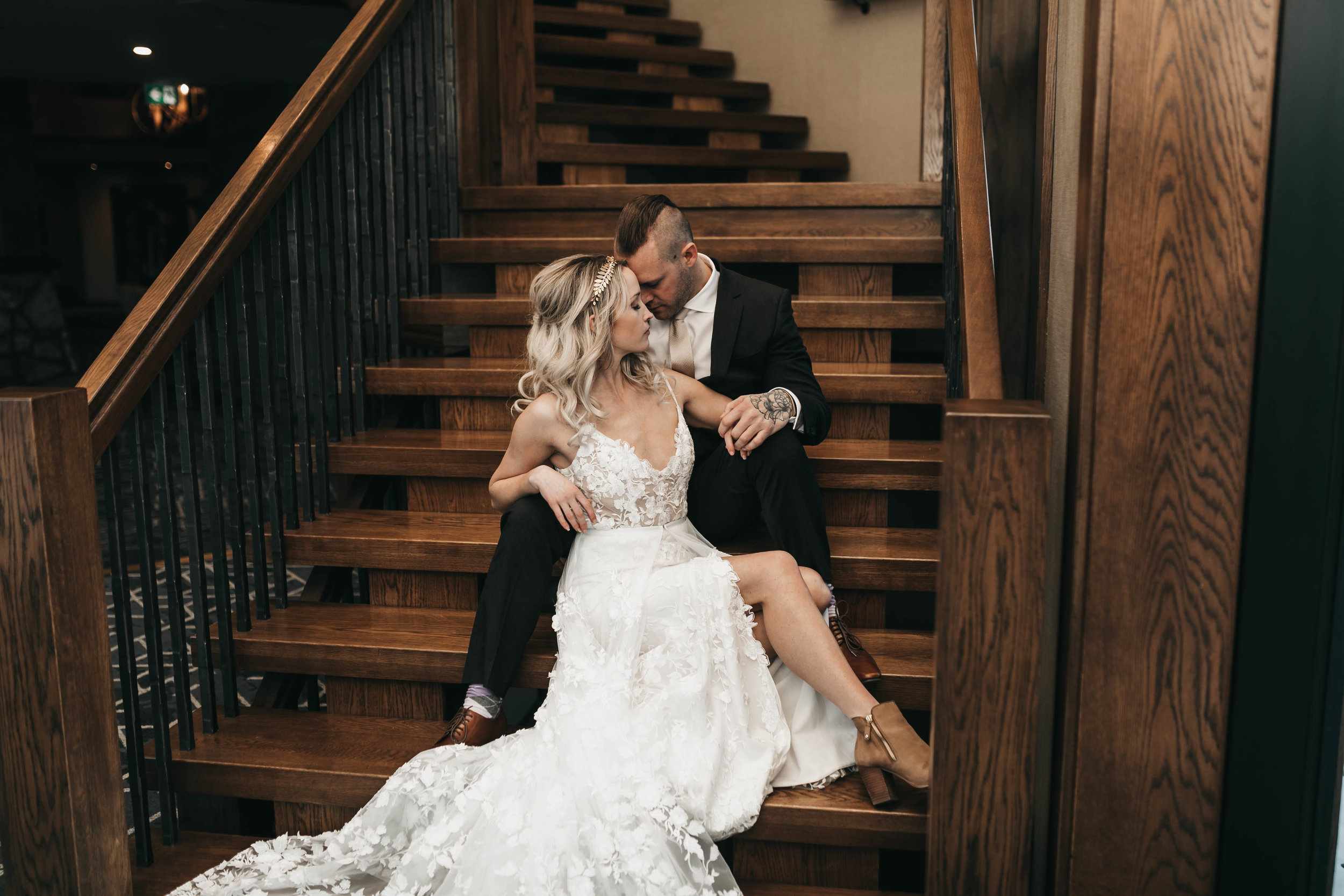Bride and groom on stairs at Malcolm Hotel.jpg