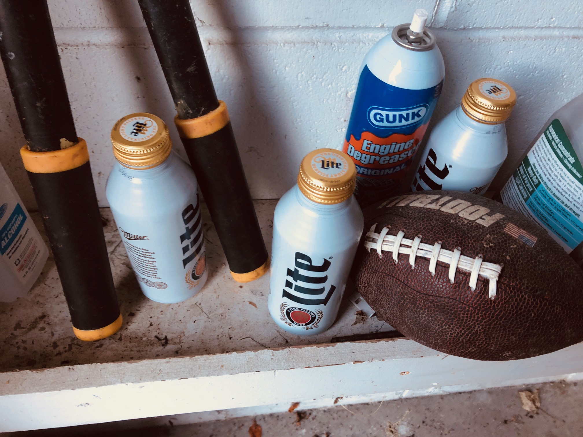 Engine de-greaser, solvents, a pigskin and a trio of empties.
