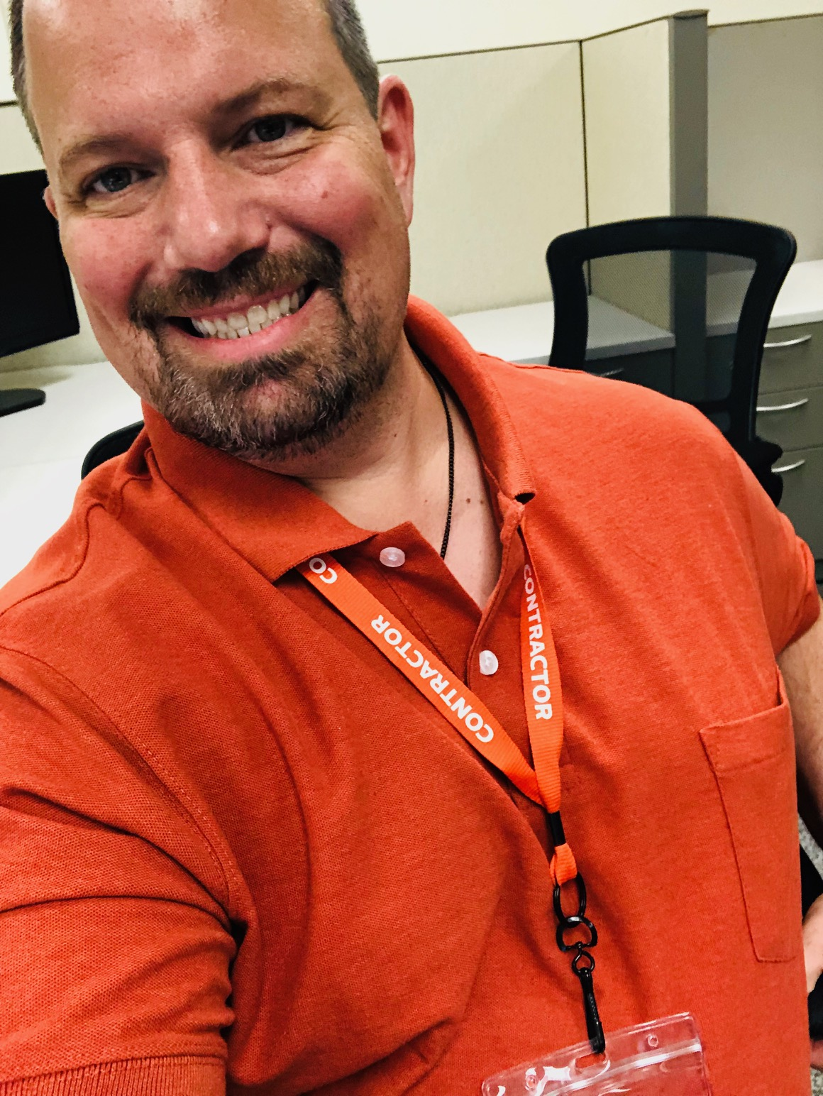 The 2 XL orange polo from DXL. Next shirt size down—Kohl's next door.