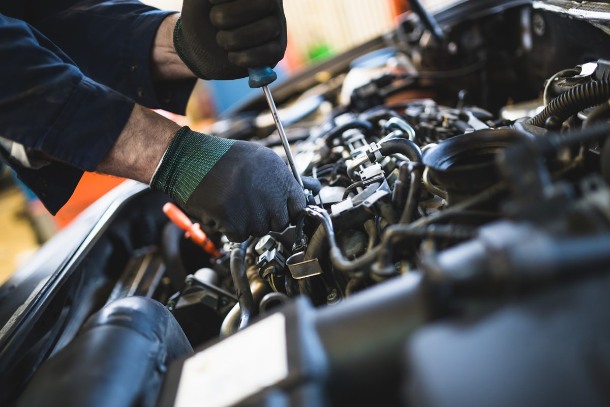 car mechanic repairing vehicle in San Diego