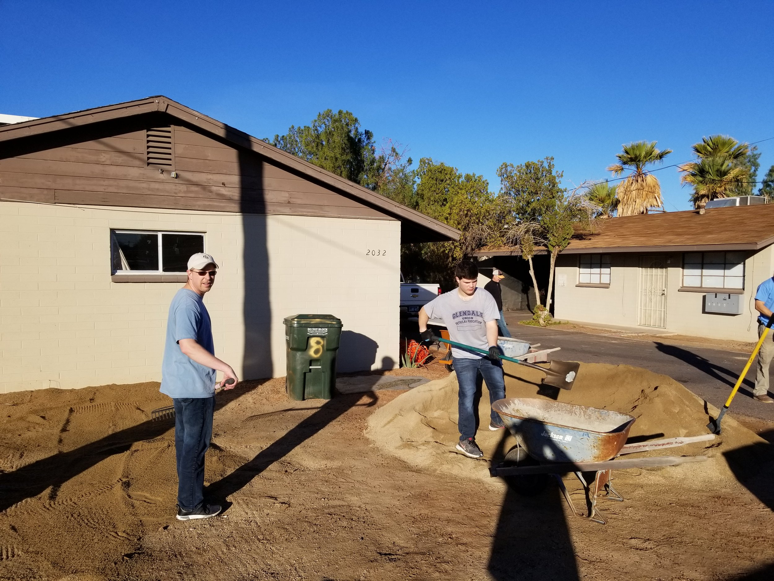Brett and Nicholas building a parking area