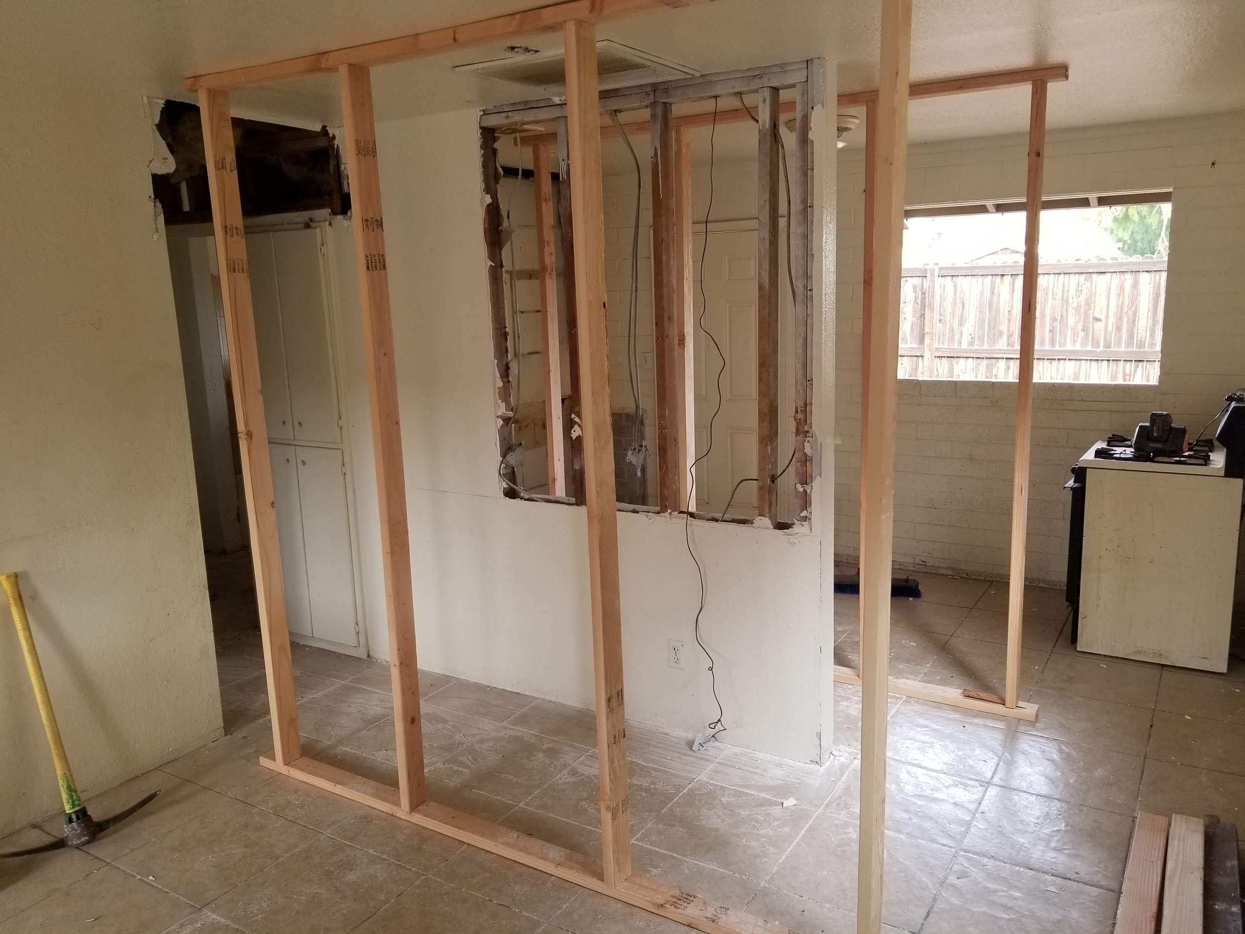 Temp wall to cut wall and install beam