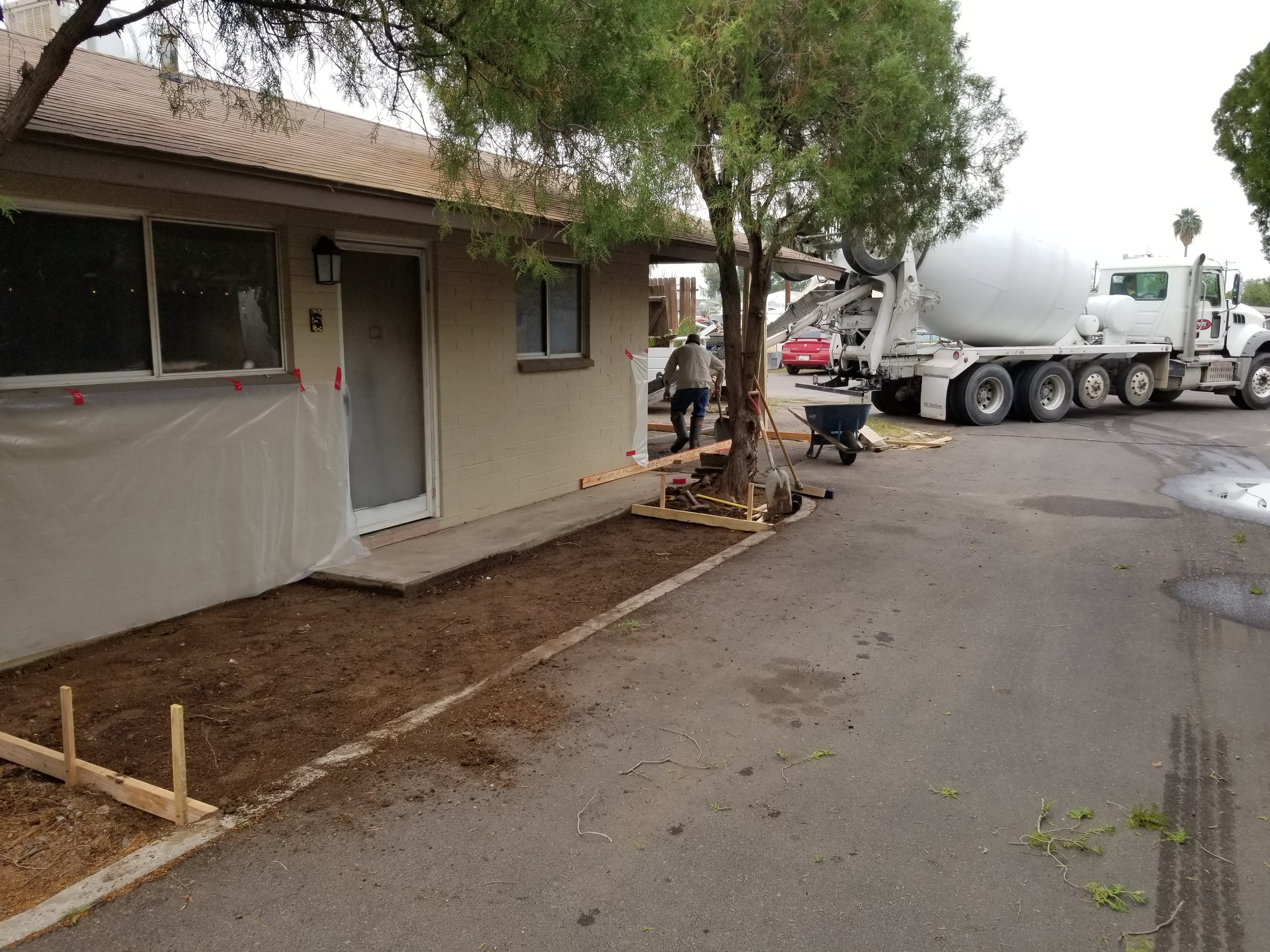 Pouring the concrete for new front patio