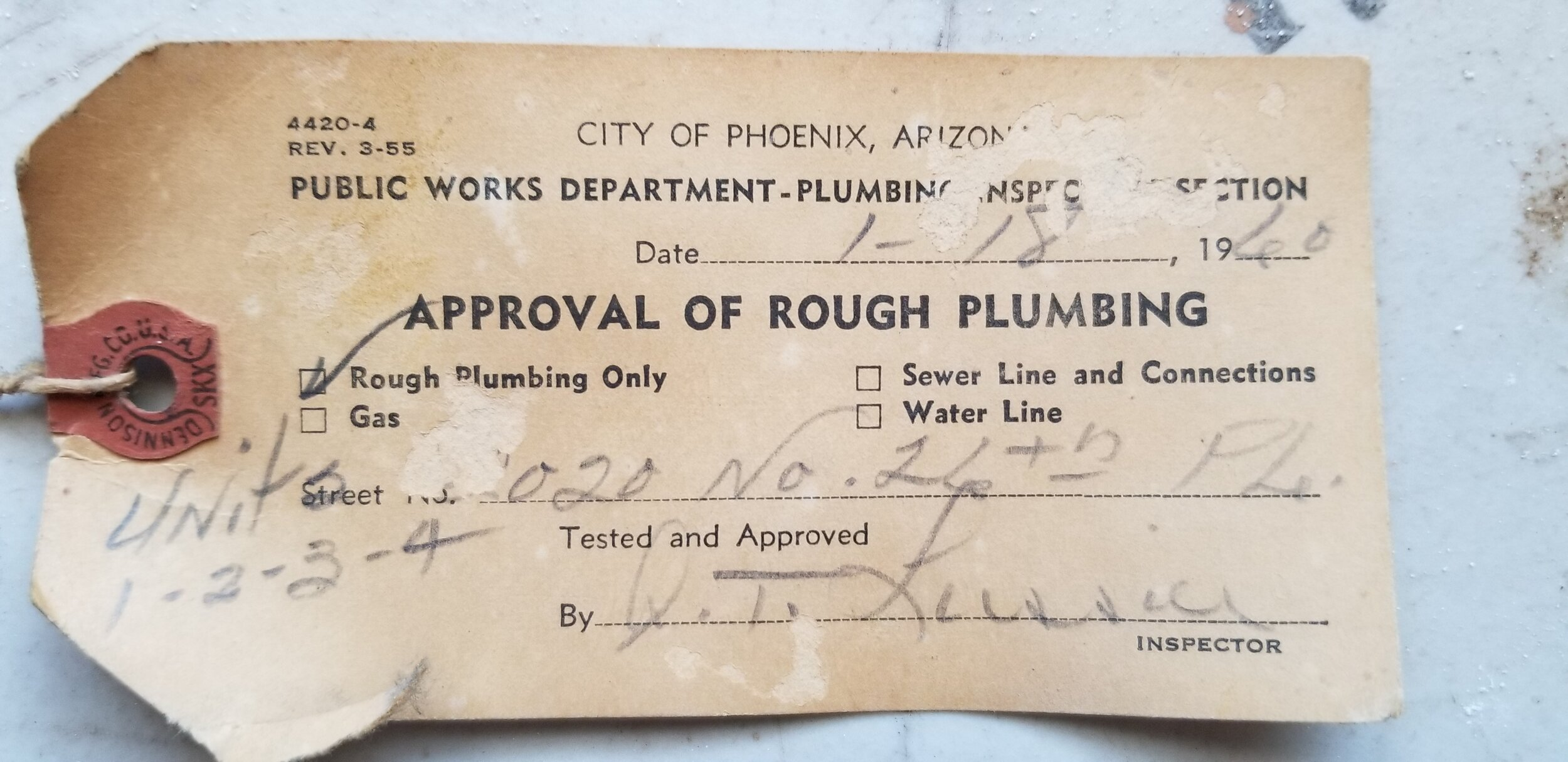 Original inspection tag found in the wall