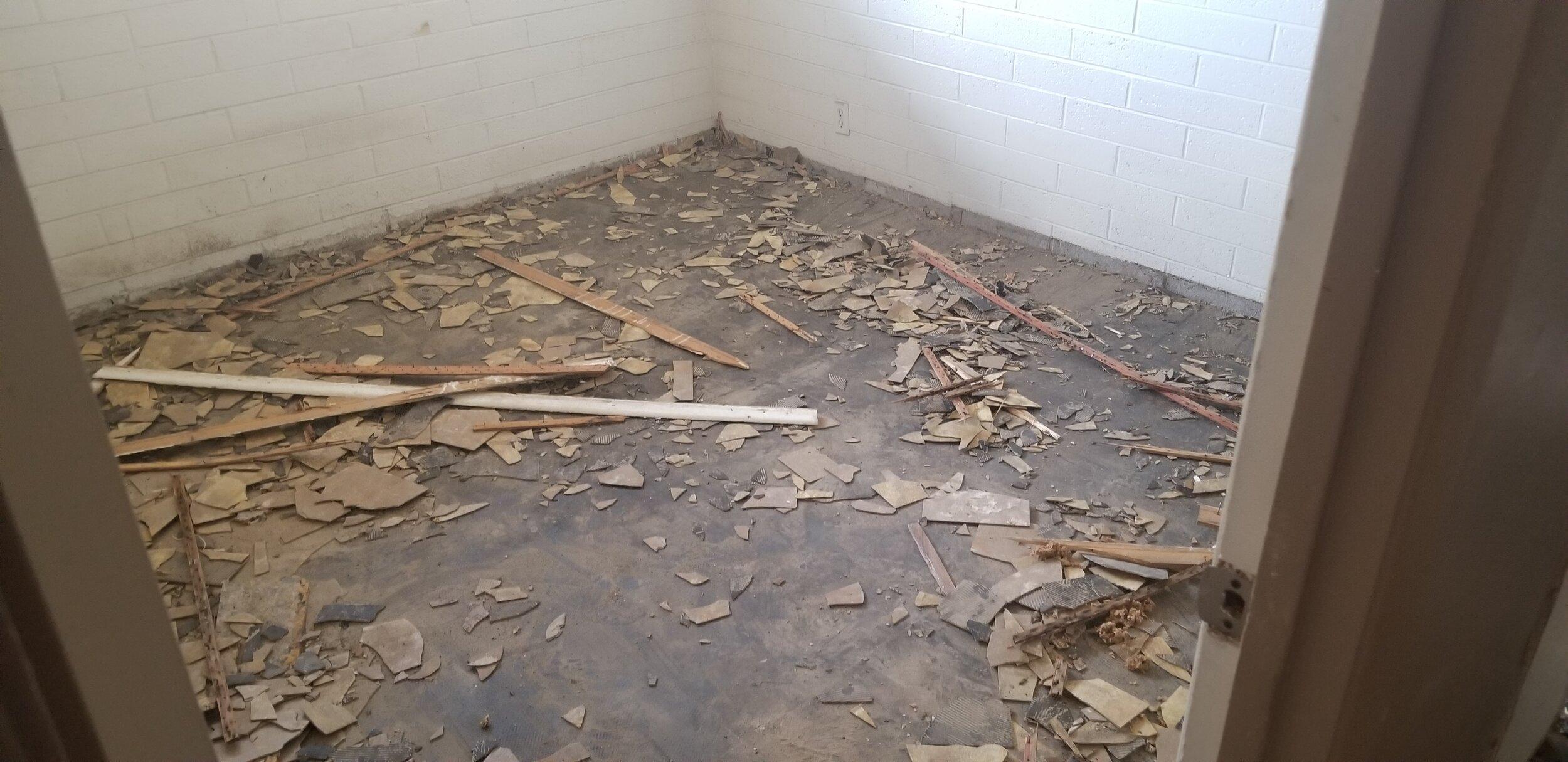 Existing bedroom asphalt tile removal