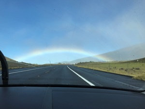 This was taken from the car on Christmas day 2016 on the way to Kona airport. This was my send off picture to NY. The Rainbow lead us, we went through it was on our side in front.. Amazing beyond my wildest dreams.