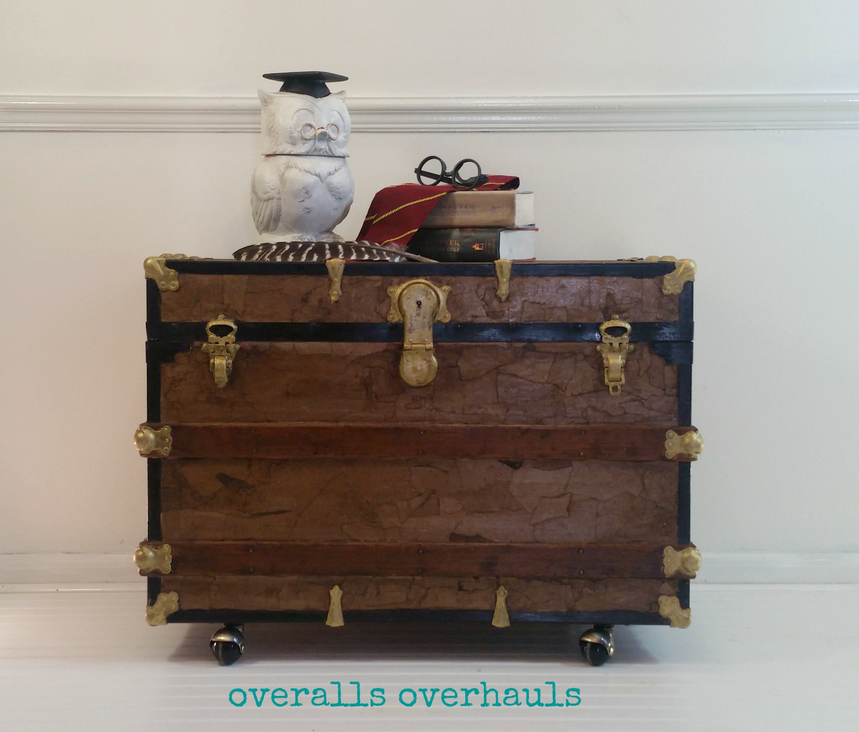 This is the finished product. Replaced the old really rusty built-in wheels with these casters. Refinished bits of wood, hardware and metal and adding a faux leather finish. I think it's adorable! Good for a coffee table - store games inside, end table, night stand or at the foot of a bed.