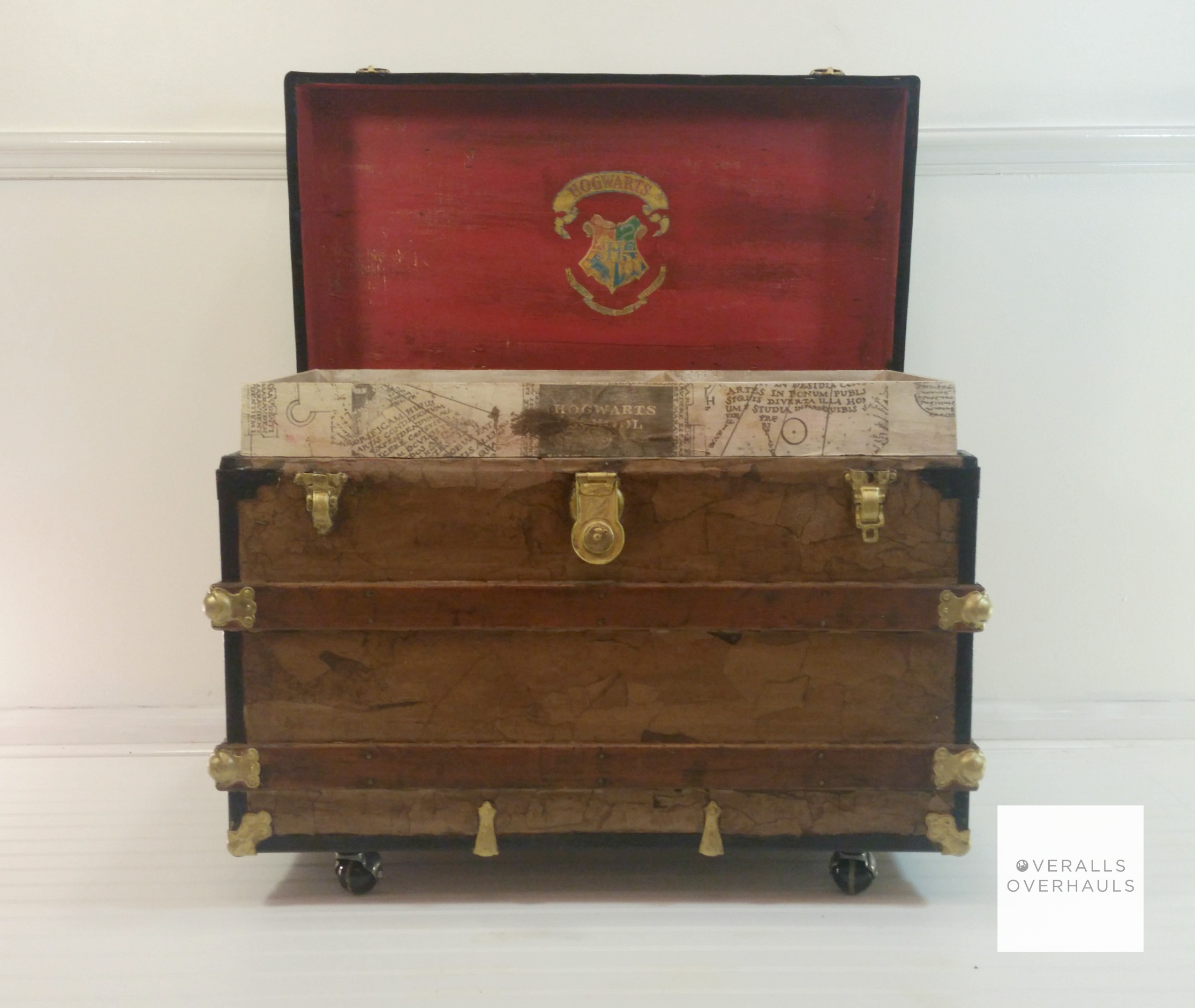 The inside is the fun part! Distressed red lid with the Hogwart's crest. The lift out drawer that sits right inside the trunk is covered with portions of the Marauder's map.