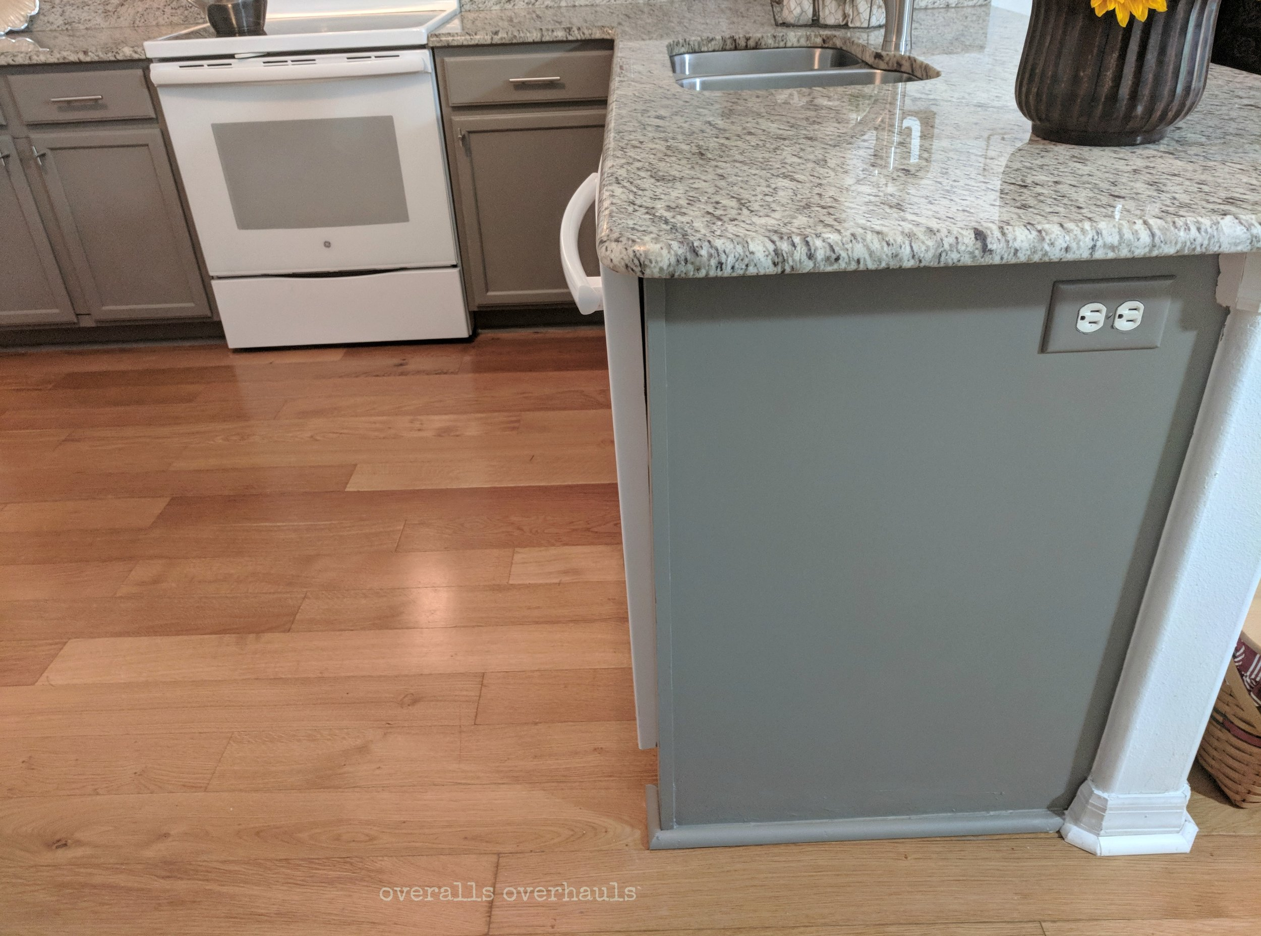 We repaired some old water damage on the floor and added new molding on this end panel.