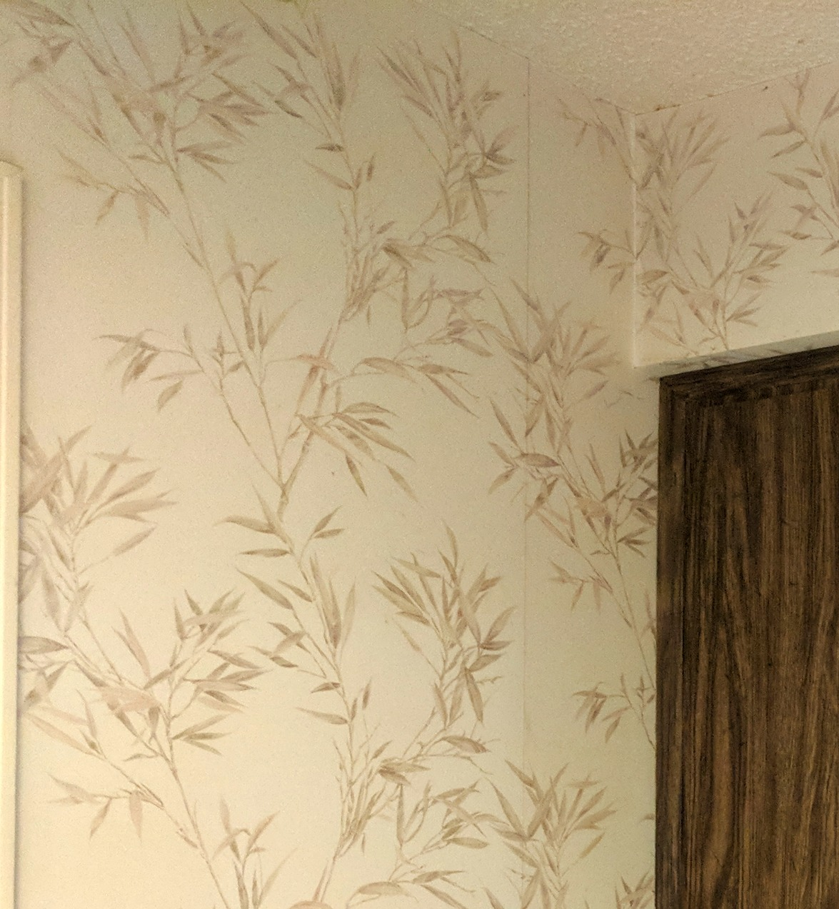 Kitchen, utility room and powder room - covered in this original builder's grade wallpaper applied directly to drywall!