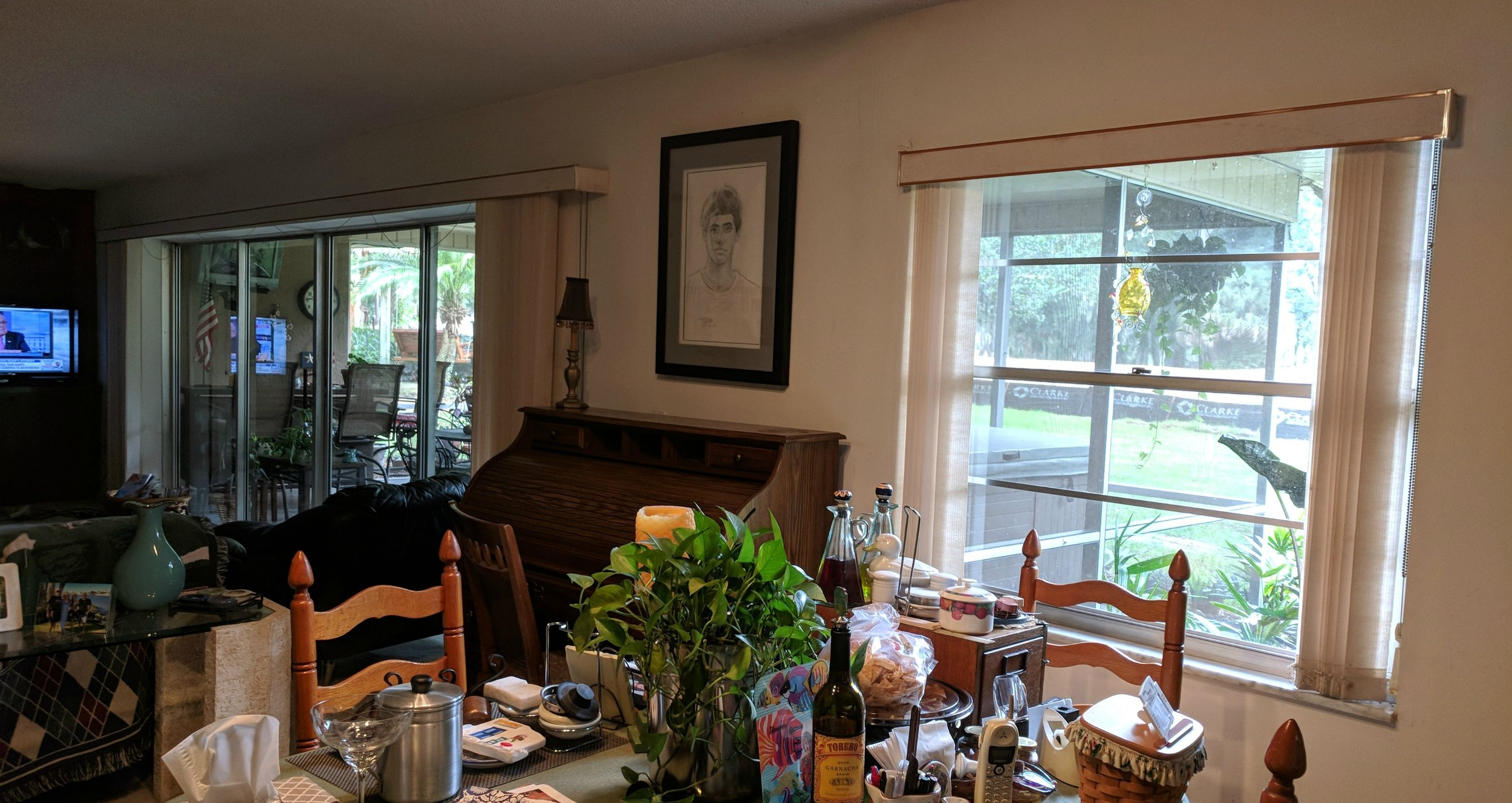This is the other side of the living room. That sliding door is bigger than many garage doors. The windows are just amazing. And, yes, I had the tv on the whole time because they have cable! We don't have cable. I binged on HGTV and bad movies. Still having withdrawals.