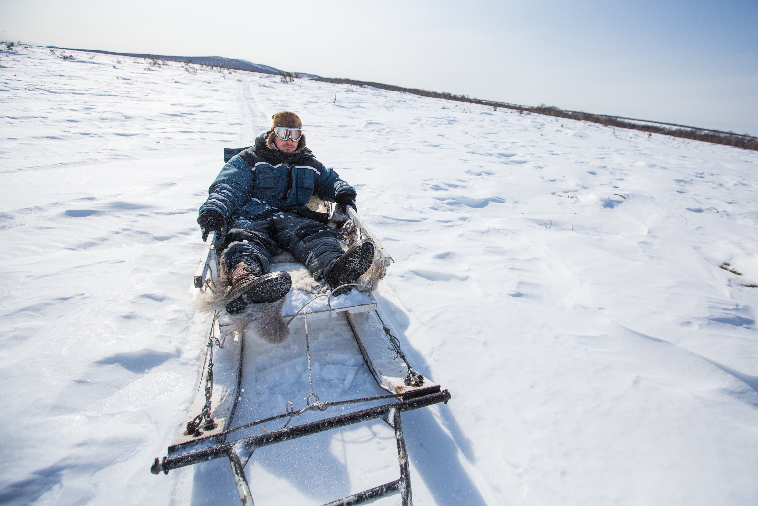 A sled pulled by a snowmobile cuts through the tundra in central Kamchatka.