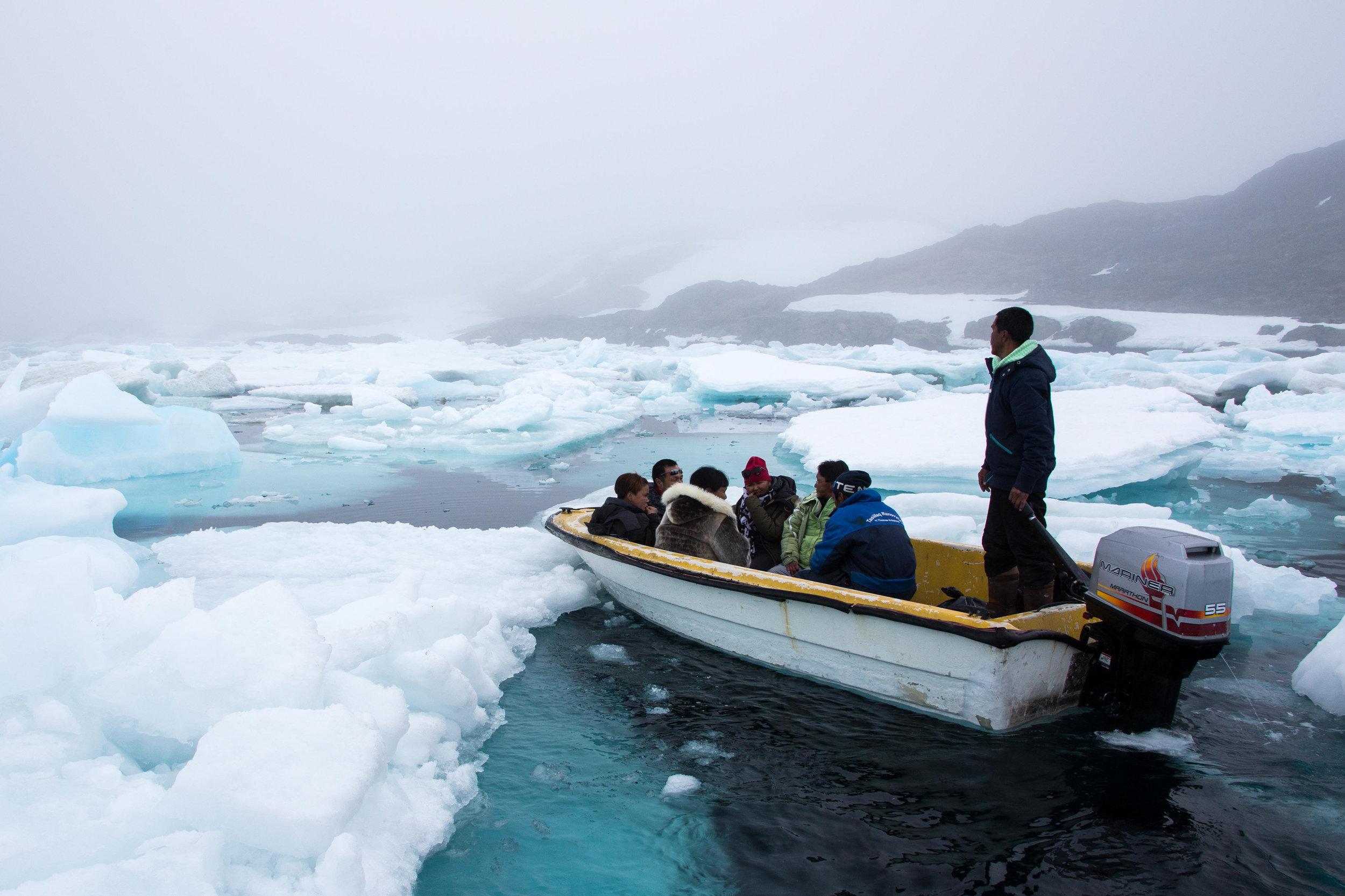 Local Tunumiut travel around icebergs by boat,Kulusuk, East Greenland. Photo: Matt Reichel.