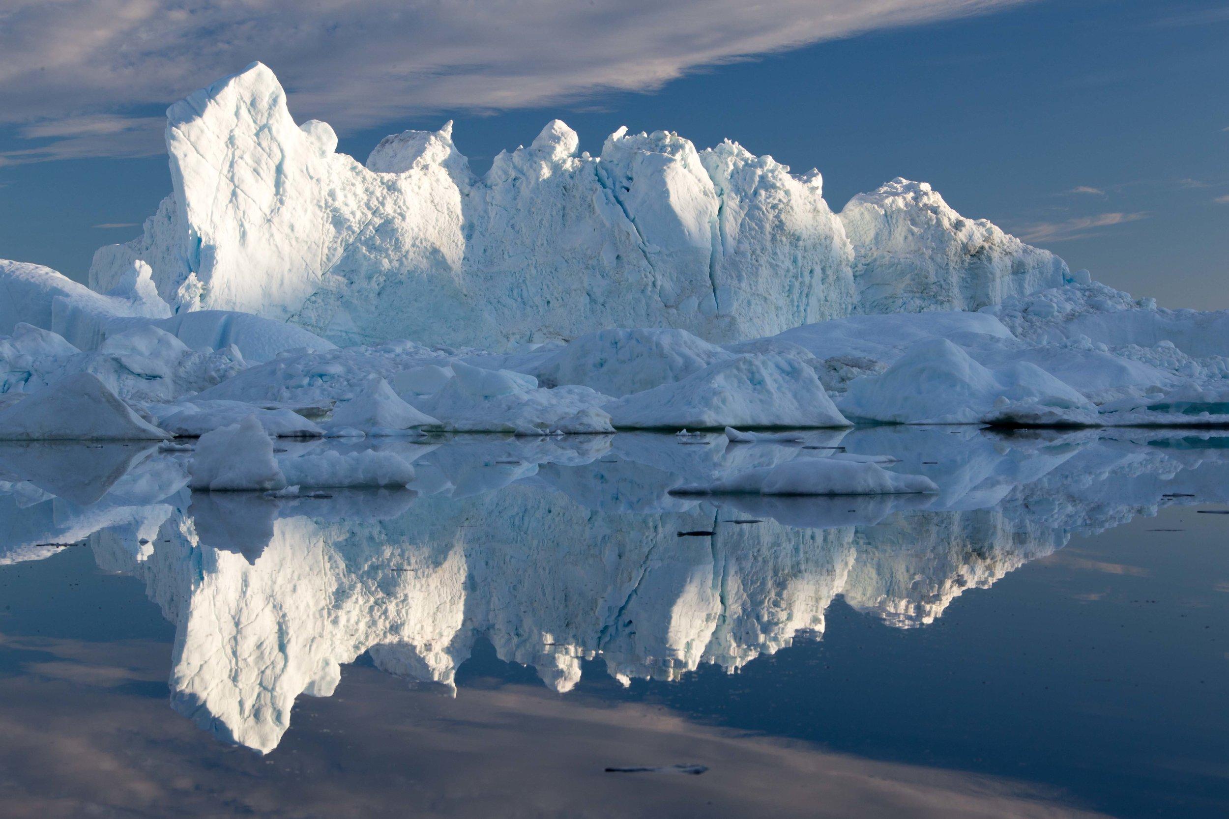 A massive iceberg rests in the Ilulissat Ice Fjord, West Greenland. Photo: Matt Reichel.