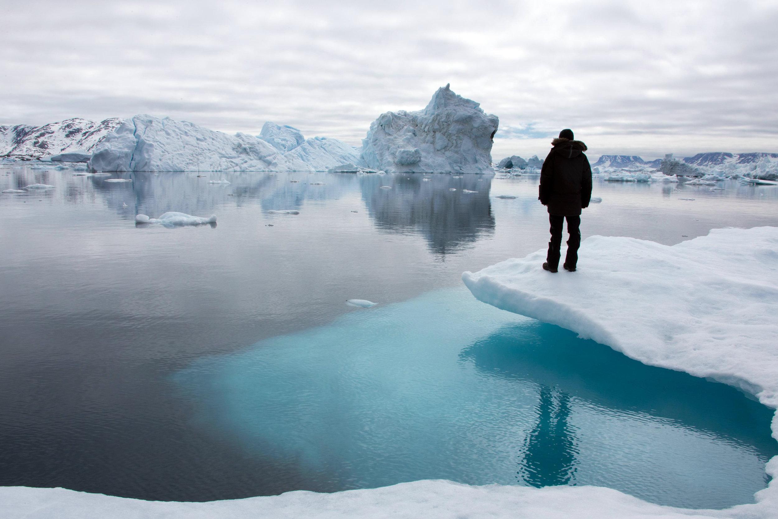 Standing on an iceberg off the coast of Tinit, East Greenland. Photo: Matt Reichel.