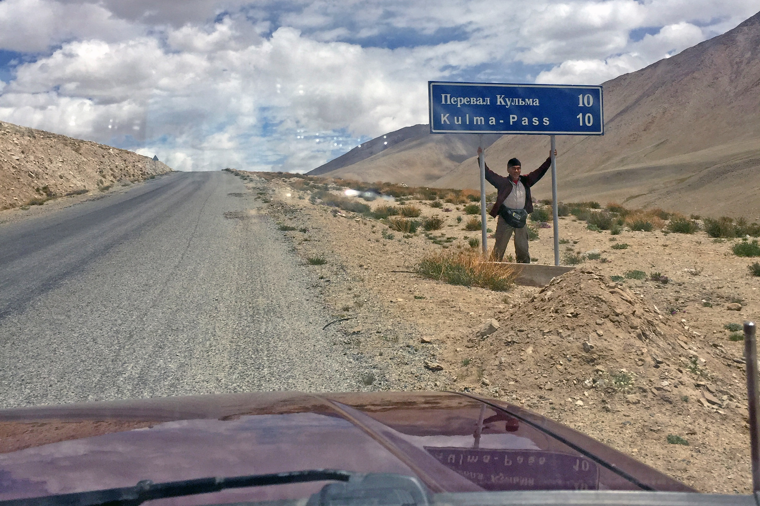 A sign announcing the 10km mark to the Kulma Pass from the Tajik side.