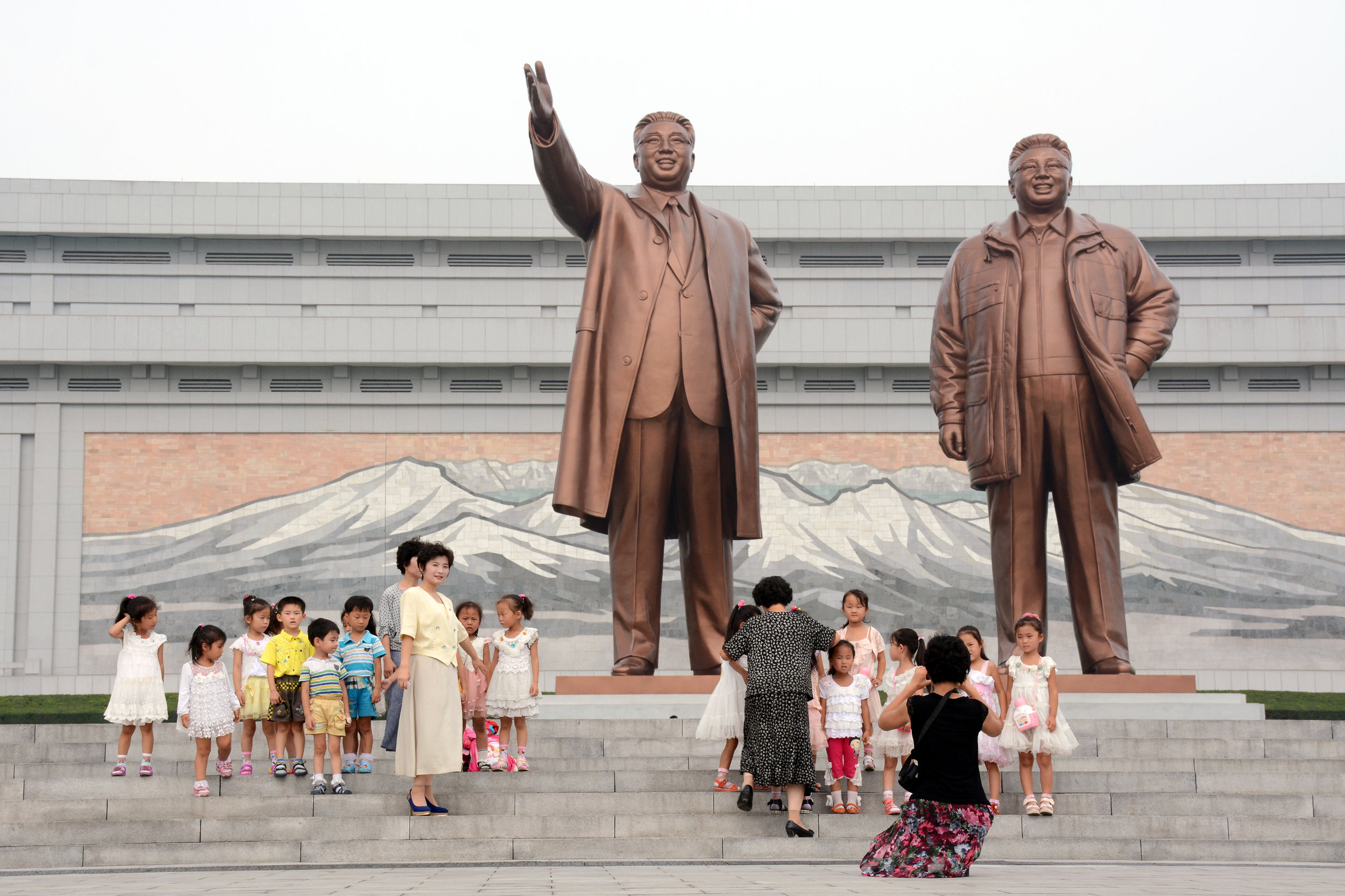 Kindergarten students pose with their teachers at the Mansudae Grand Monuments in Pyongyang.