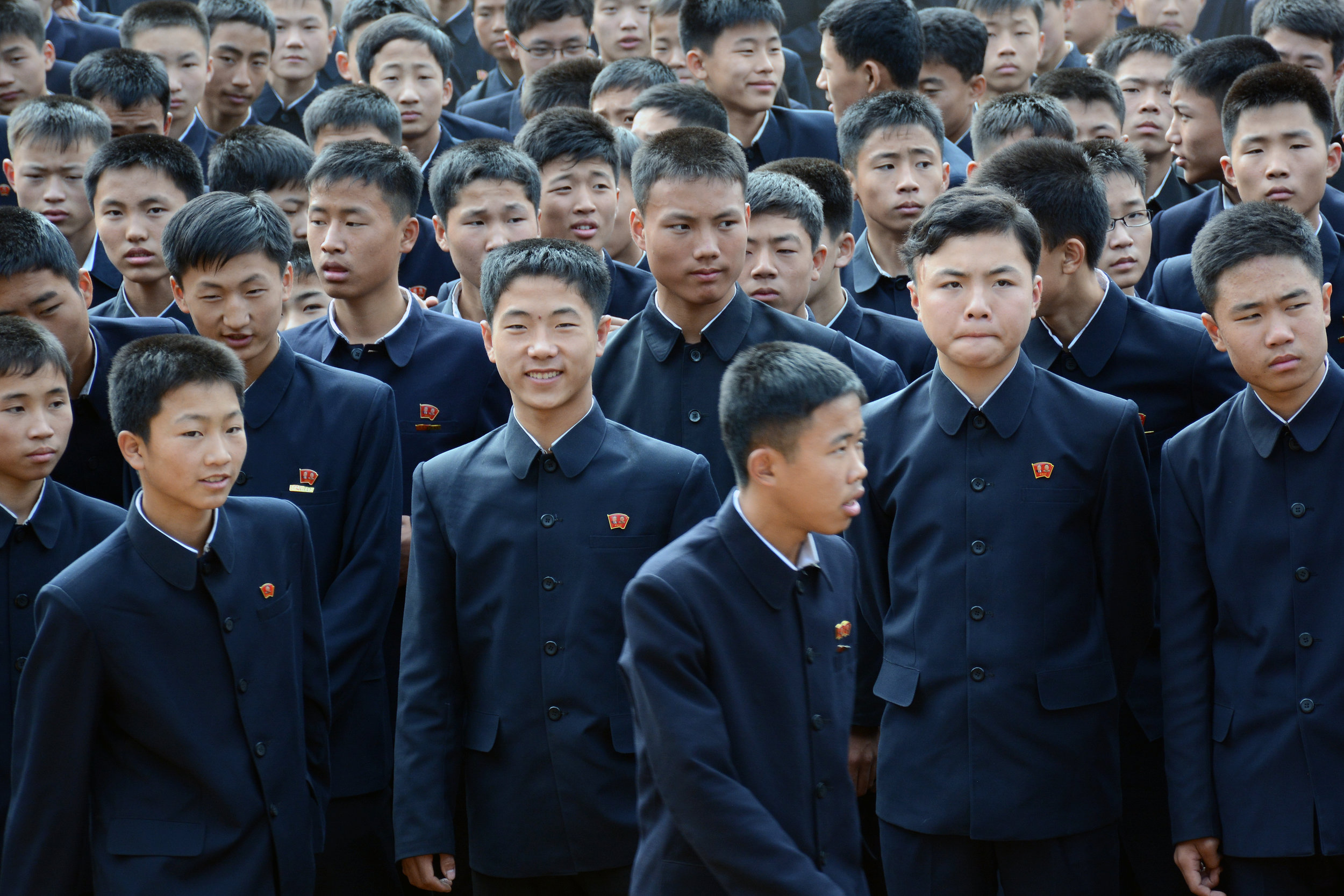 Middle school students gather outside for their daily calisthenics routine in Pyongsong city, North Korea.