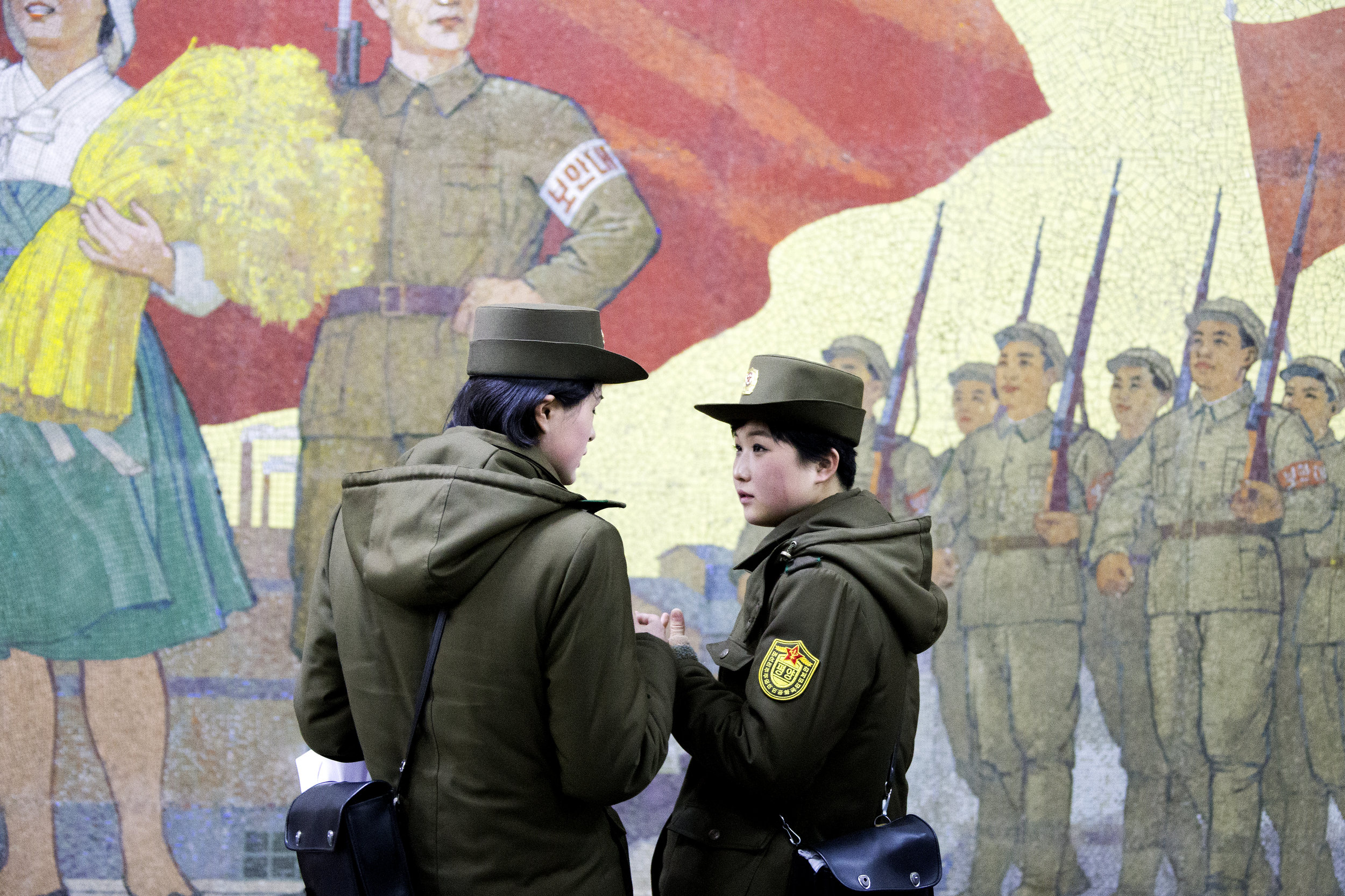 Two security guards stand on the platform of Kaeson Station in the Pyongyang Metro.
