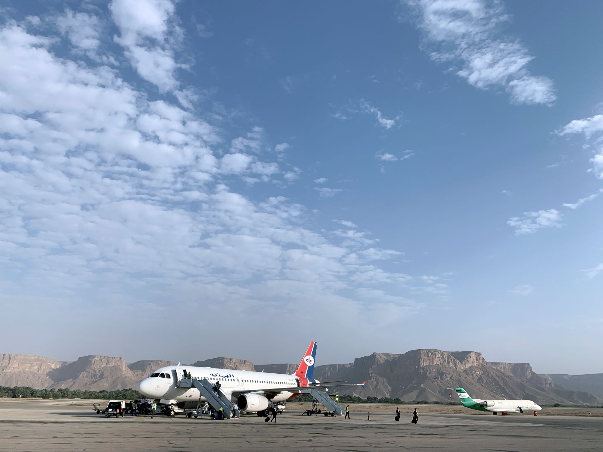 The Yemenia flight from Cairo to Seiyun to Socotra waits for transit passengers at Seiyun Airport.