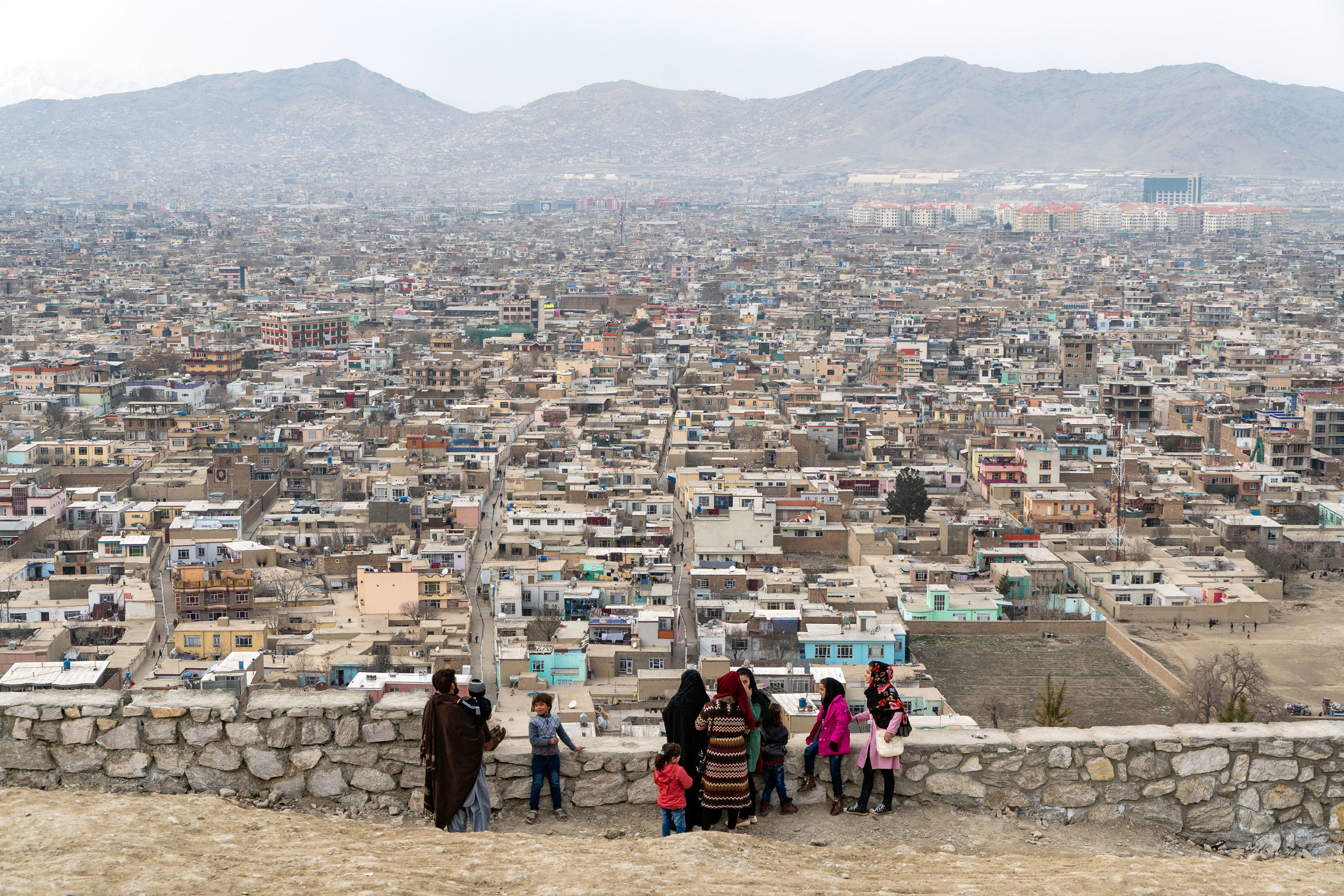 An Afghan family takes in the views over Kabul from Bibi Mahroo Hill.