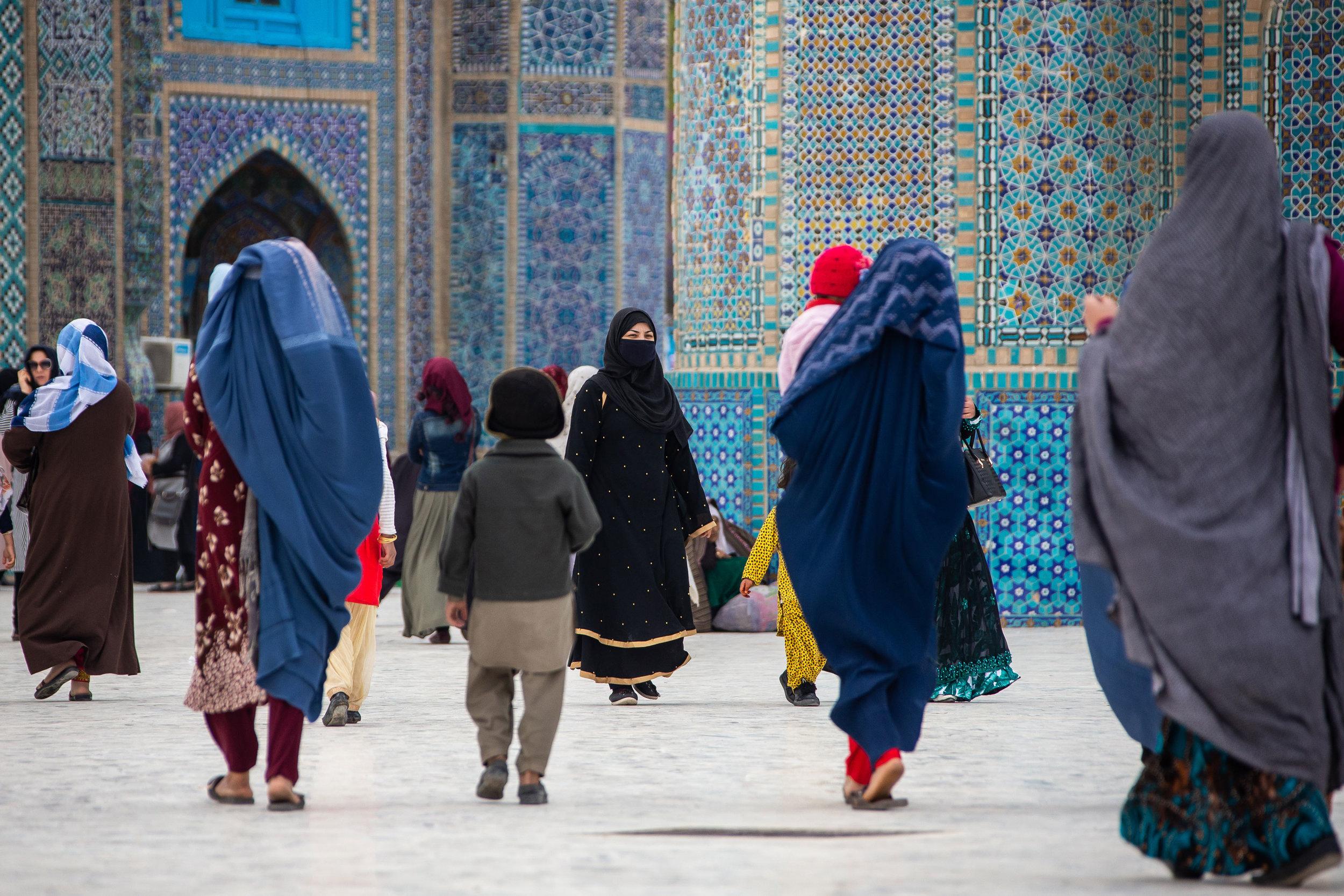 Women walk around the Blue Mosque in Mazar-i Sharif.