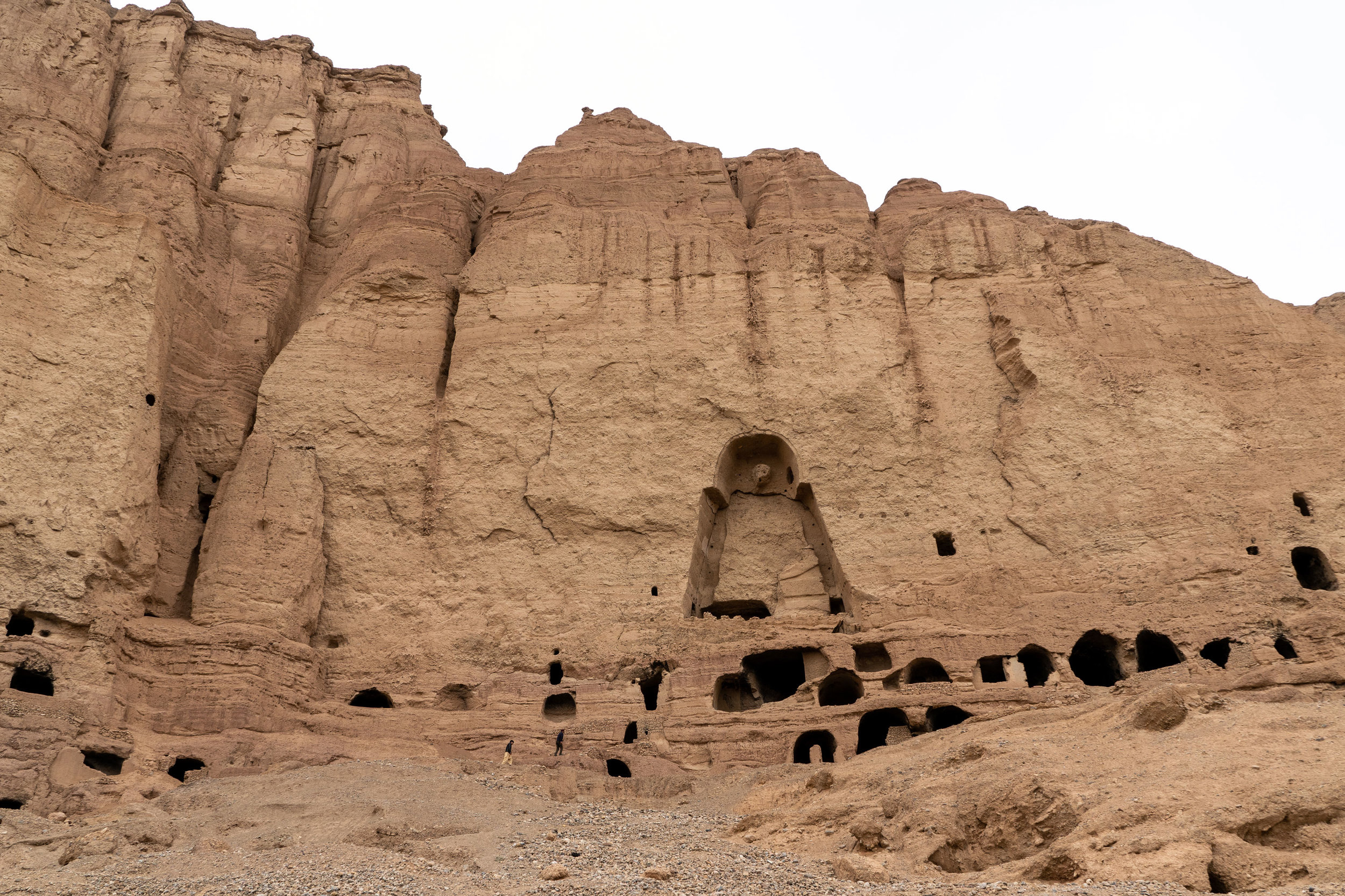 The great Buddha Niches of Bamyan were largely destroyed by the Taliban in 2001. Despite international condemnation, the Taliban destroyed this world heritage city dating back to the 5th century because they saw the statues as anti-Islamic. Today, the niches sit largely empty. Some statue outlines may be seen and remnants of colourful paintings can be found inside some of the caves. While others are covered in ash from people having been living in them and others in graffiti and footprints defacing some of the ancient Buddhist paintings.